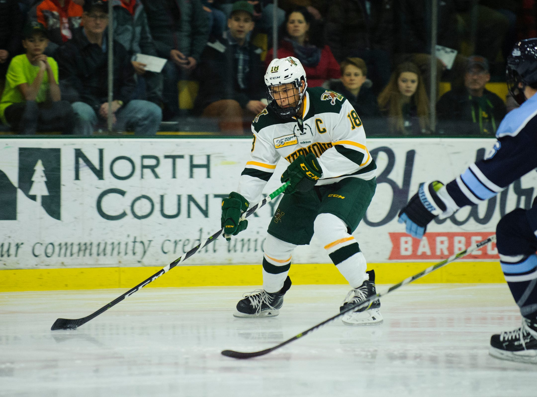 Vermont defenseman Matt O'Donnell (18) looks to take a shot during the men's hockey game between the Mine Black Bears and the Vermont Catamounts at Gutterson Field House on Friday night November 30, 2018 in Burlington.