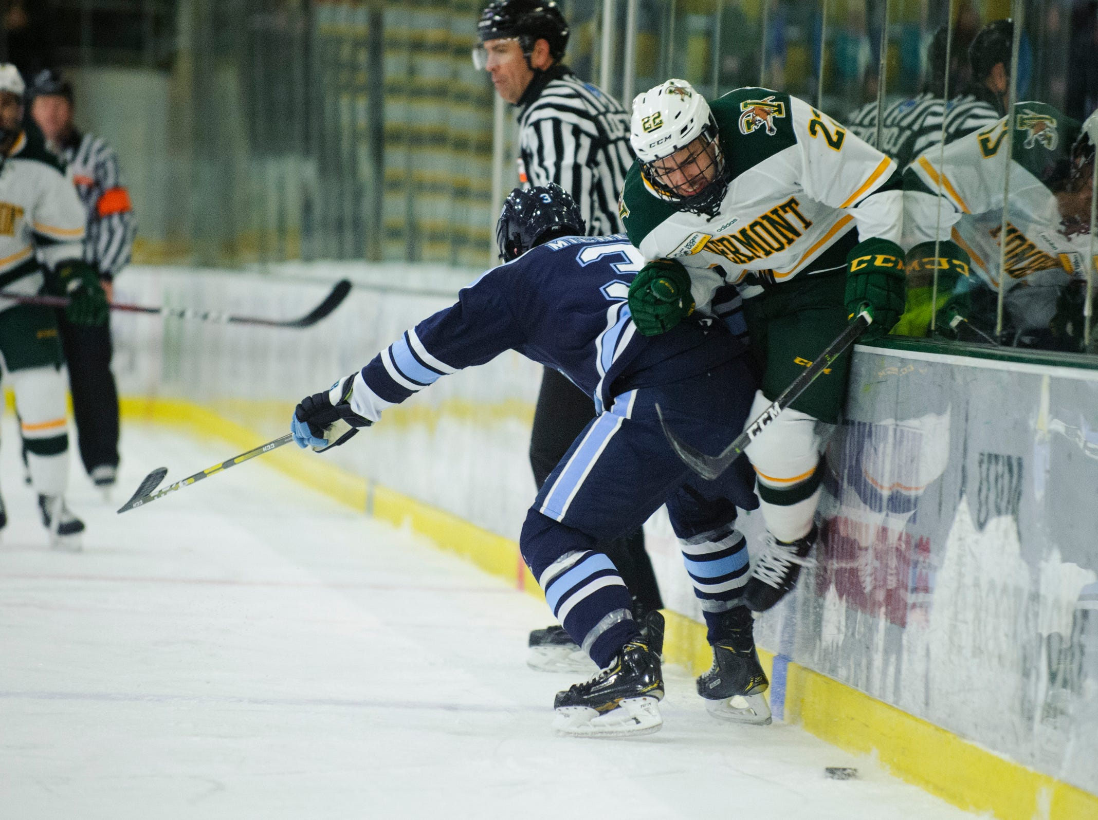 Maine's Rob Michel (3) checks Vermont forward Alex Esposito (22) into the boards during the men's hockey game between the Mine Black Bears and the Vermont Catamounts at Gutterson Field House on Friday night November 30, 2018 in Burlington.