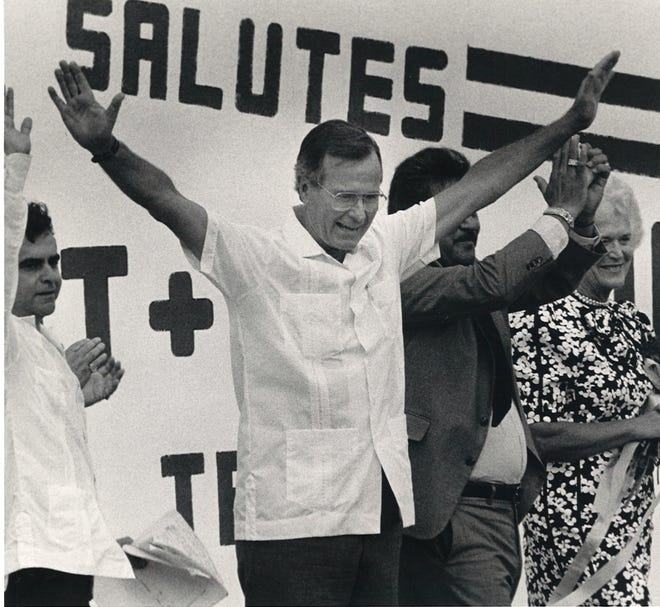 "Vice President George H.W. Bush ""salutes"" the crowd at Salinas Ranch in Hebbronville, Texas on Sept. 14, 1985."