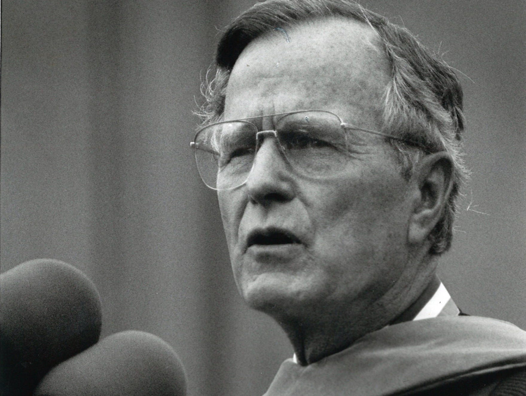 President George Bush delivers his commencement address at Texas A&I University on May 11, 1990. Bush stressed America's need to return to the forefront in science and technology and promised to put a man on Mars in the future.
