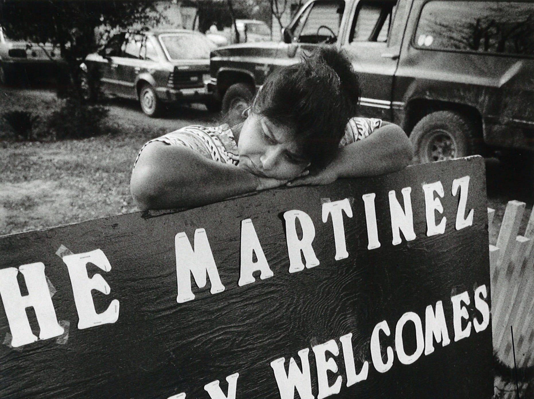 Connie Guerra waits to greet President George Bush on Dec. 29, 1992 at the home of Rachel and Rufino Martinez of Berclair, Texas where he usually stops to talk to the residents during his annual quail hunts at the Lazy F Ranch. Guerra and six others waited more than three hours, but the president never showed up.