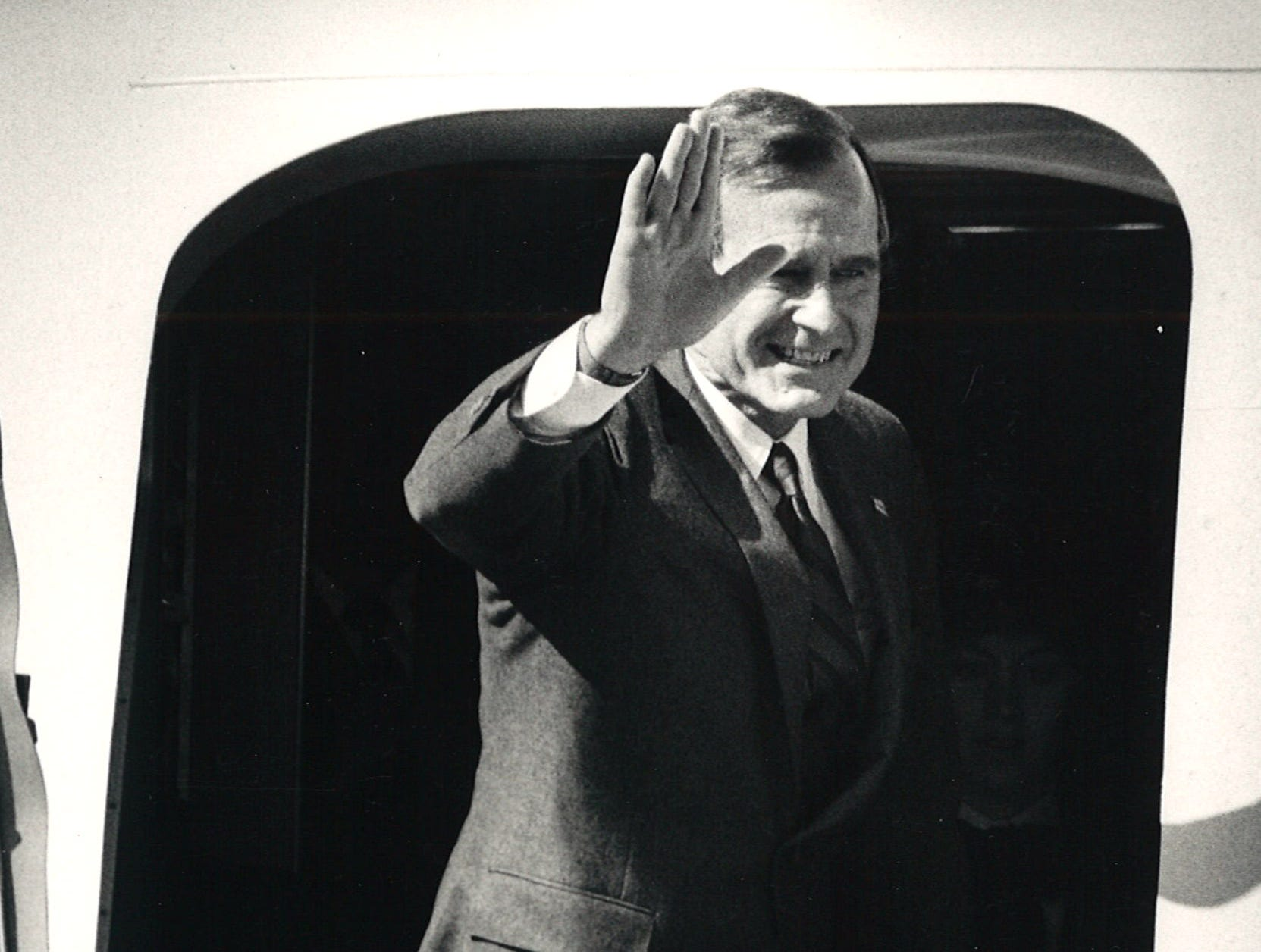 Vice president George Bush waves goodbye to Corpus Christi's Naval Air Station outside the cabin door to Air Force Two on March 4, 1986. He was winding up a four-day visit to Texas.