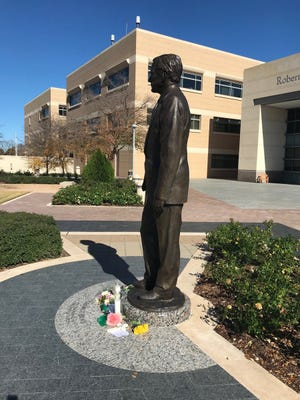 Tributes at the statue of former President George H.W. Bush outside his presidential library in College Station on Dec. 2018.