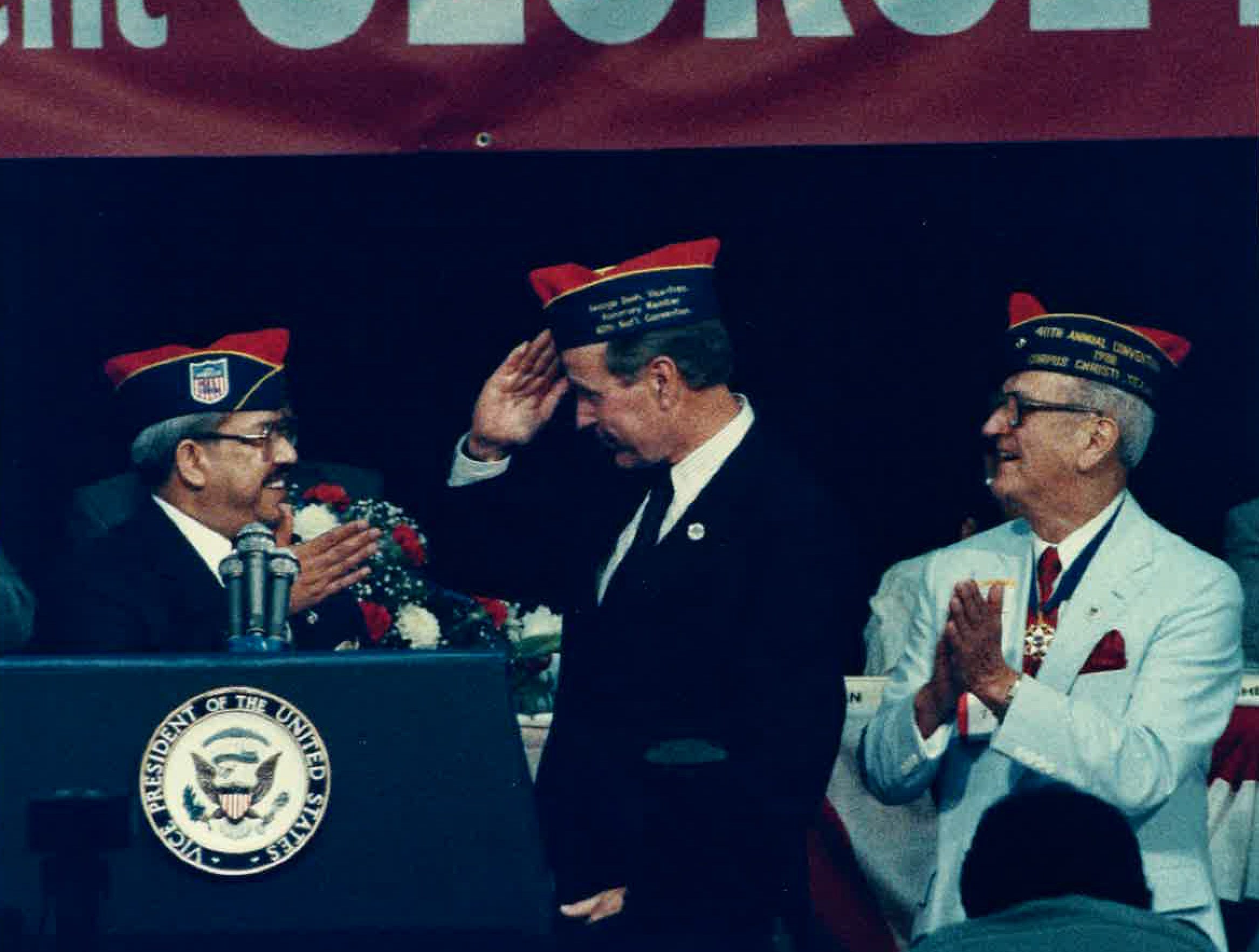 Vice President George H.W. Bush (center) salutes National Chairman of the American G.I. Forum Mario Diaz (left) as GI Forum founder Dr. Hector P. Garcia looks on. Bush was in town for the national convention of the American GI Forum in August 1988.