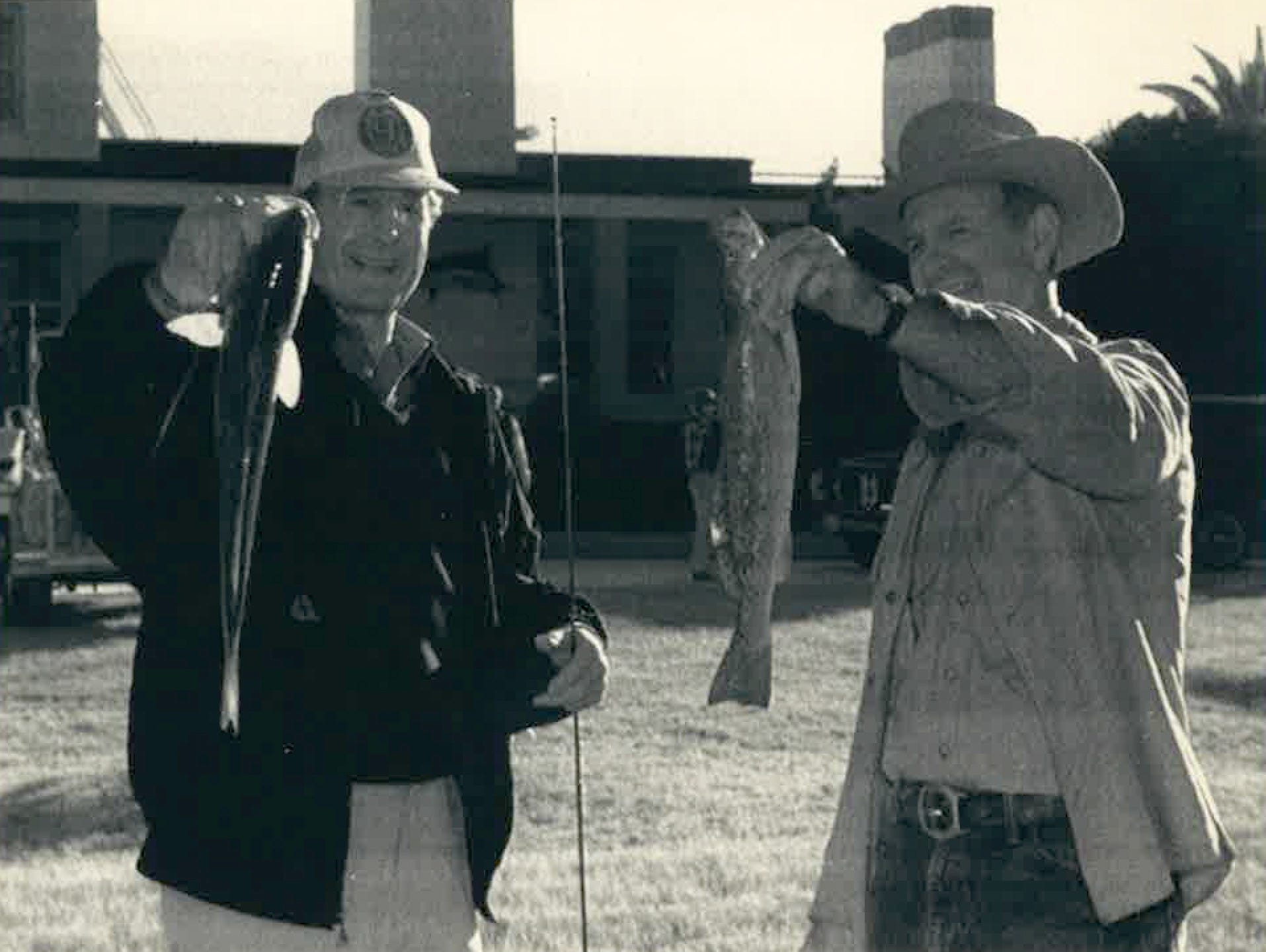 President George H.W. Bush and Secretary of State James Baker show off their catches on San Jose Island in December 1989.