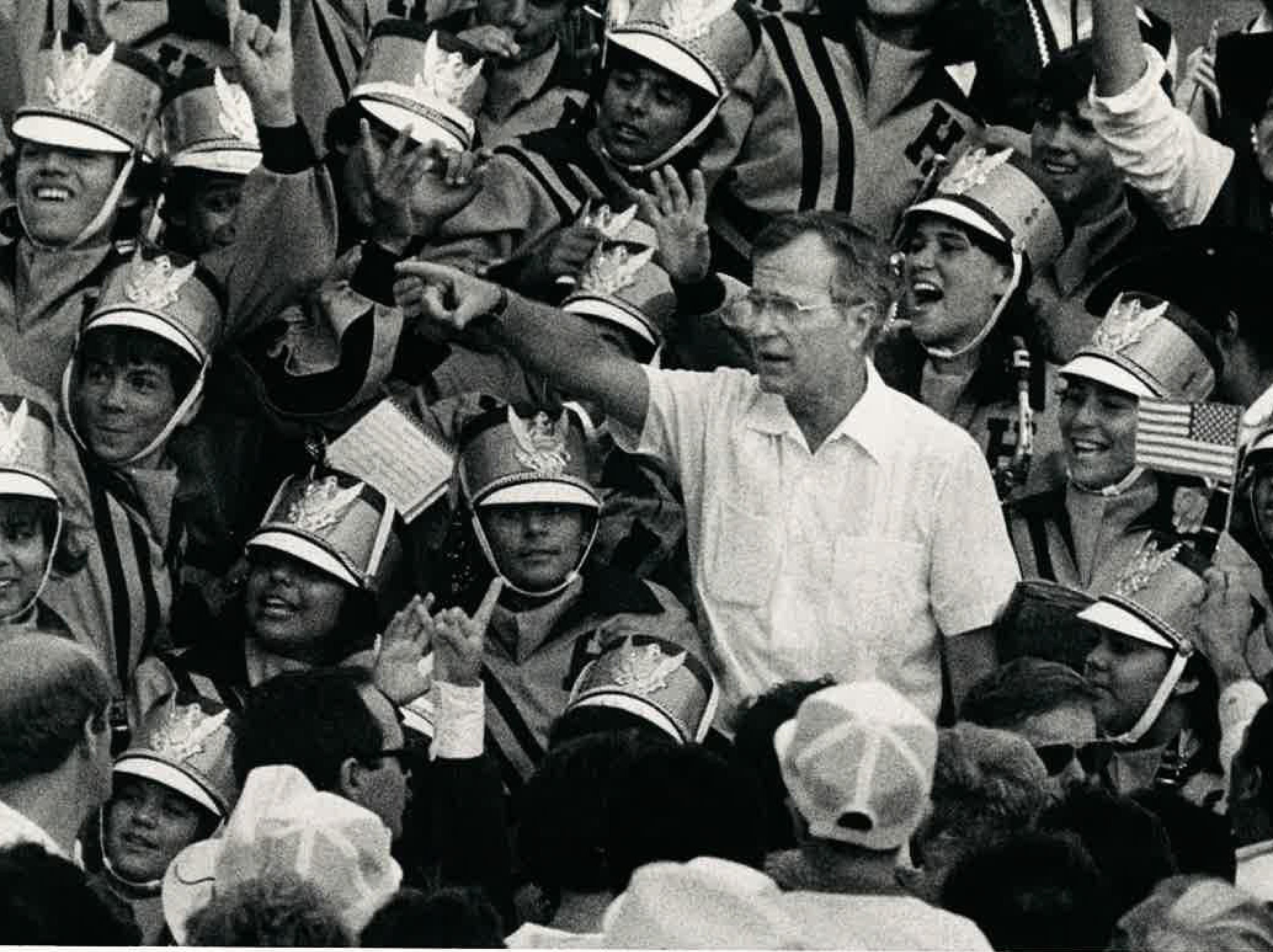 Vice President George H.W. Bush points out his wife Barbara at the podium as members of the Hebbronville band wave in September 1985.