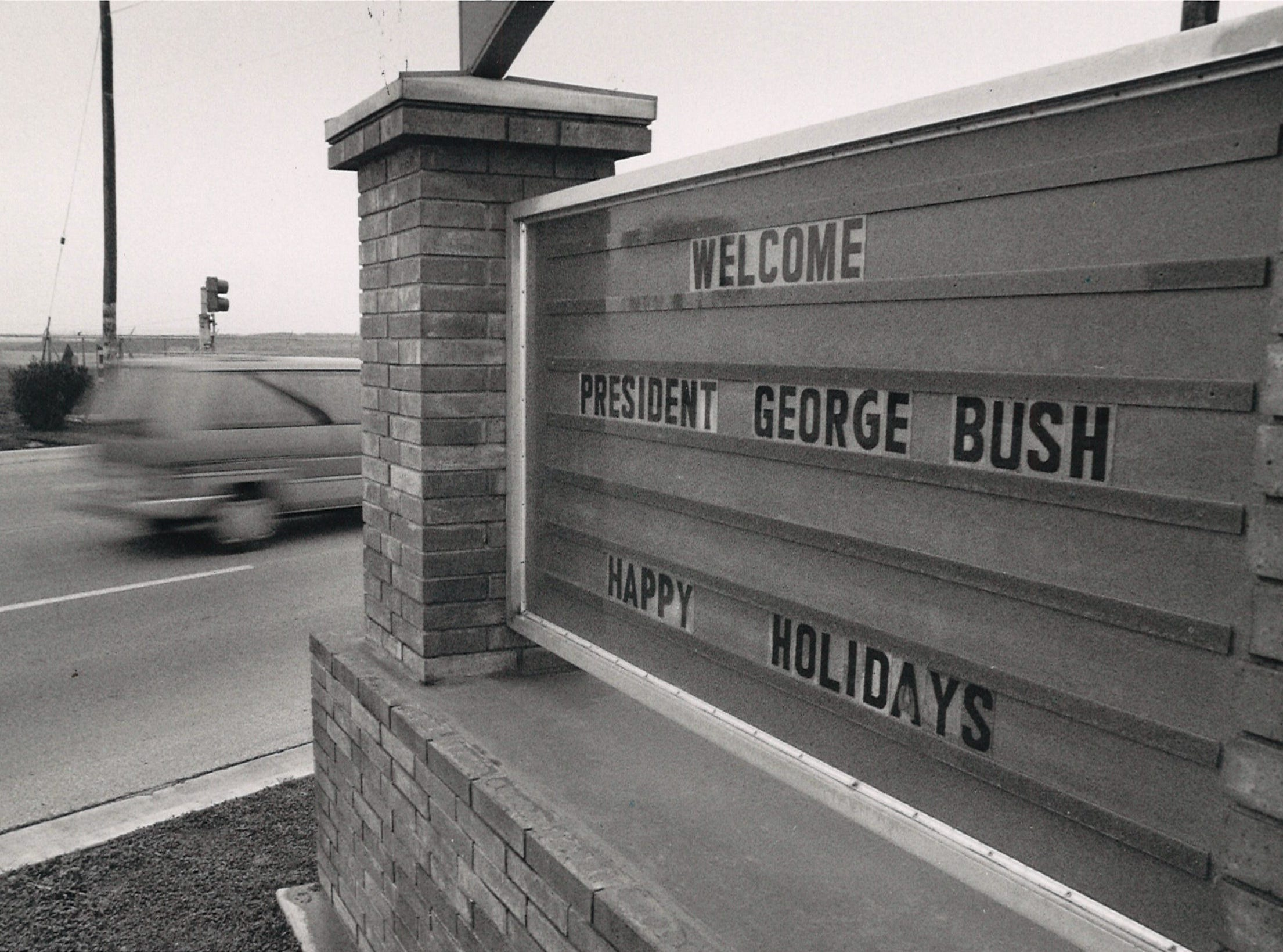 A sign at the north gate of Naval Air Station Corpus Christi welcoming President George Bush on Dec. 27, 1992.