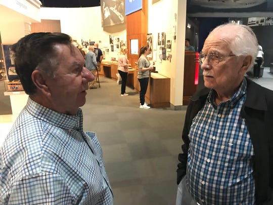 Louis Anders and Duane Wagner share memories of former President George H.W. Bush at his presidential library Saturday, Dec. 1, 2018.