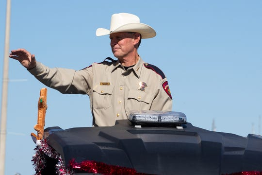 Nueces County Sheriff Chris Hooper waves from the back of a parade float during the 37th annual Harbor Lights Festival Children's Parade along North Shoreline Boulevard on Saturday, Dec. 1, 2018.