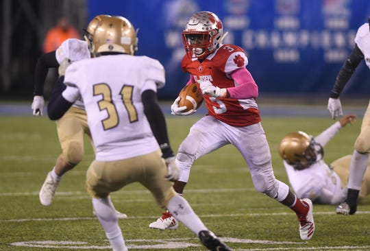 St. Joseph's Jada Byers runs for a gain against Holy Spirit. The Wildcats topped the Spartans, 41-22 at MetLife Stadium on Friday, November 30, 2018.