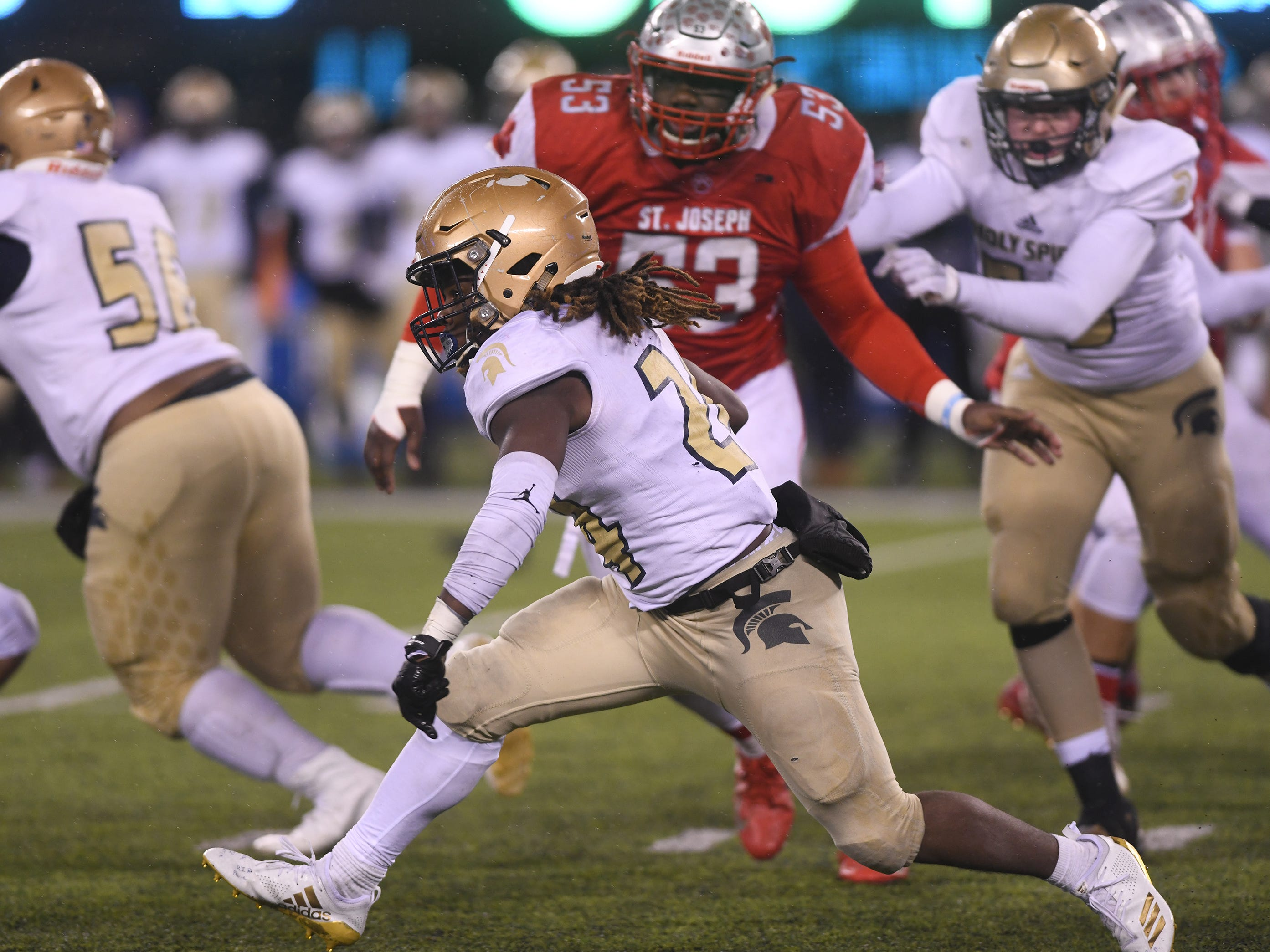 Holy Spirit's E'lijah Gray runs for a gain against St. Joseph. The Wildcats topped the Spartans, 41-22 at MetLife Stadium on Friday, November 30, 2018.