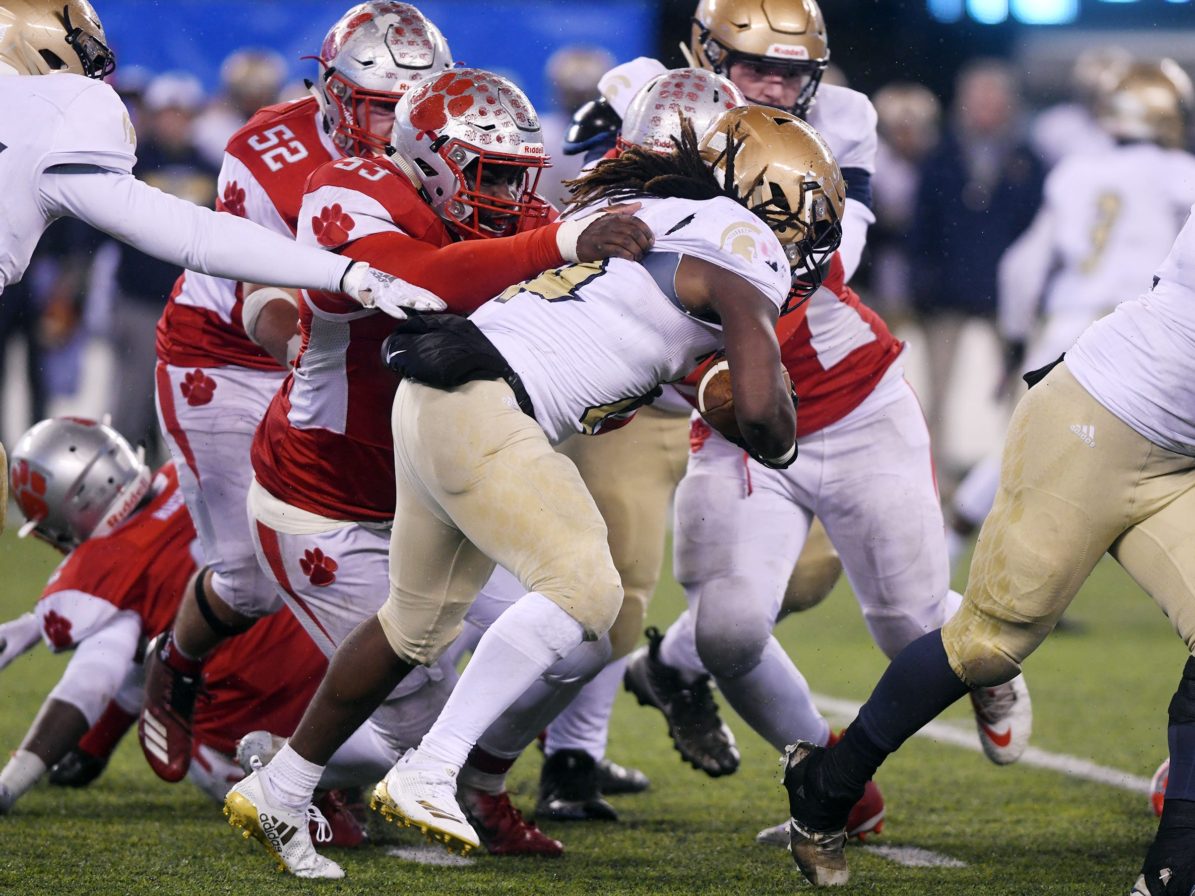Holy Spirit's E'lijah Gray is tackled by St. Joseph's Sean Morris. The Wildcats topped the Spartans, 41-22 at MetLife Stadium on Friday, November 30, 2018.