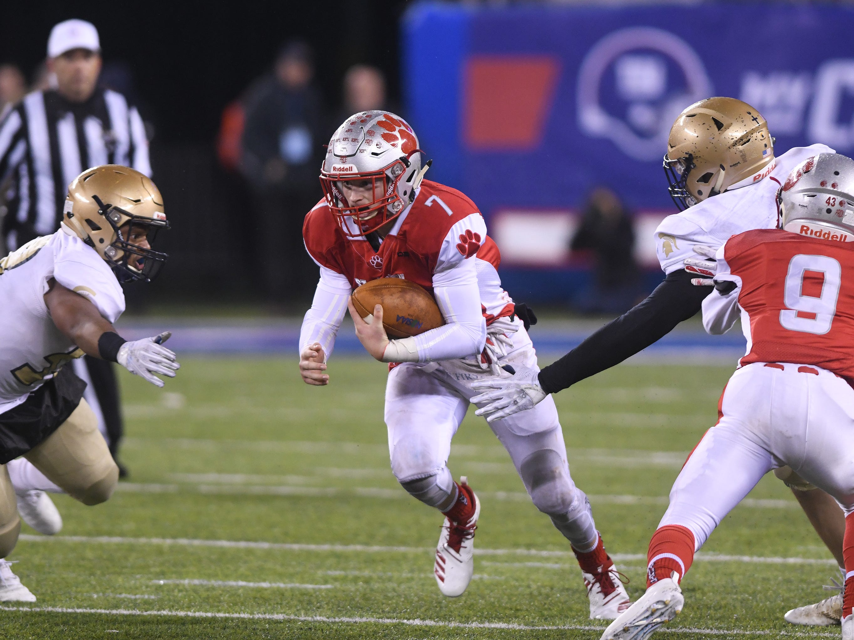 St. Joseph's QB, Jayden Shertel runs for a gain against Holy Spirit. The Wildcats topped the Spartans, 41-22 at MetLife Stadium on Friday, November 30, 2018.