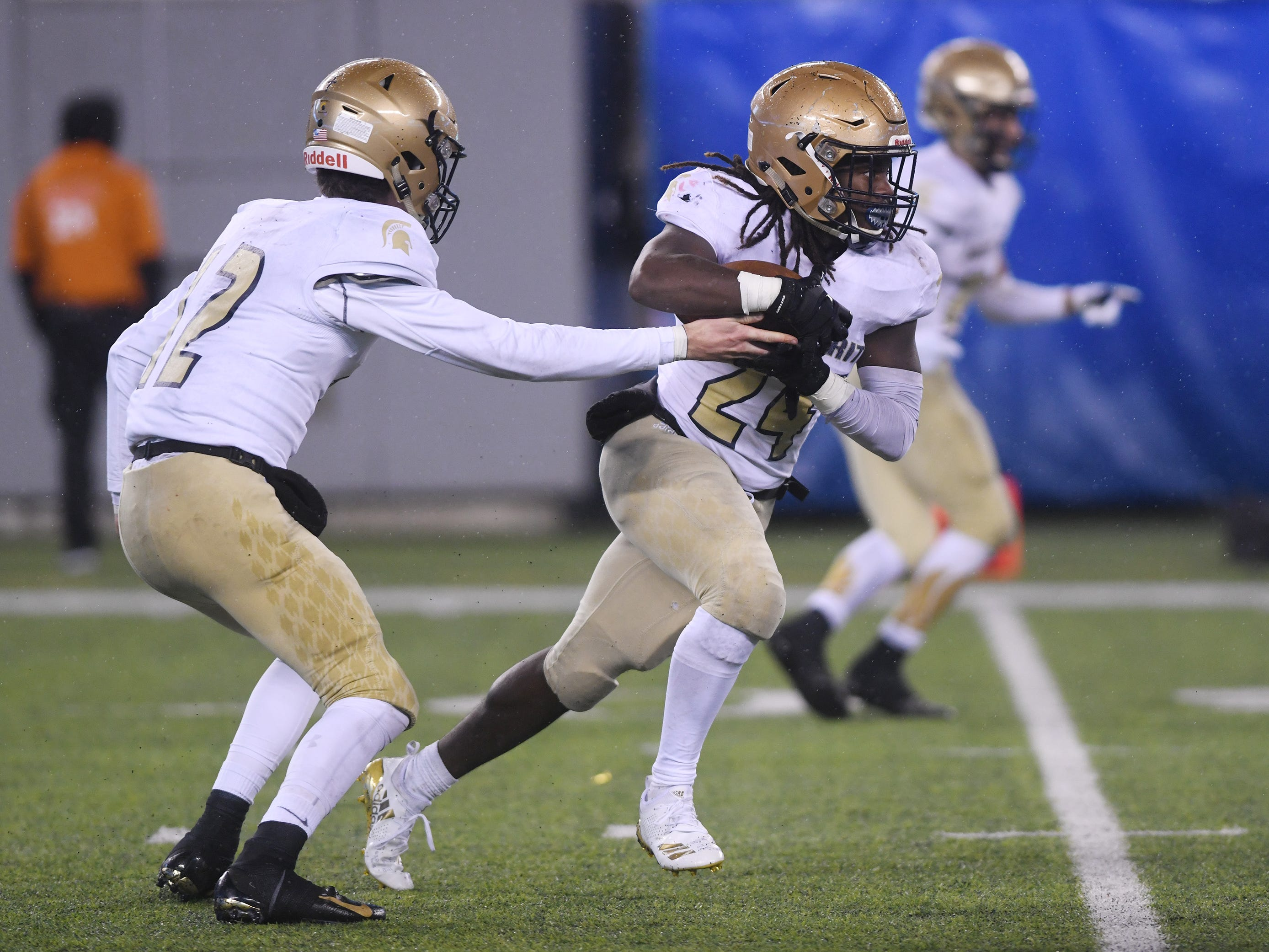 Holy Spirit's E'lijah Gray runs for a gain against St. Joseph after a handoff from Ryan Yost. The Wildcats topped the Spartans, 41-22 at MetLife Stadium on Friday, November 30, 2018.