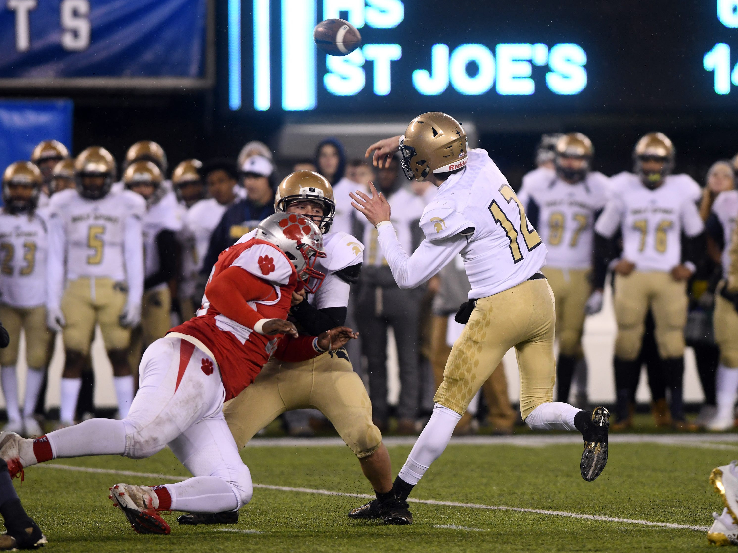 Holy Spirit's QB, Ryan Yost throws for a completion against St. Joseph. The Wildcats defeated the Spartans, 41-22 at MetLife Stadium on Friday, November 30, 2018.
