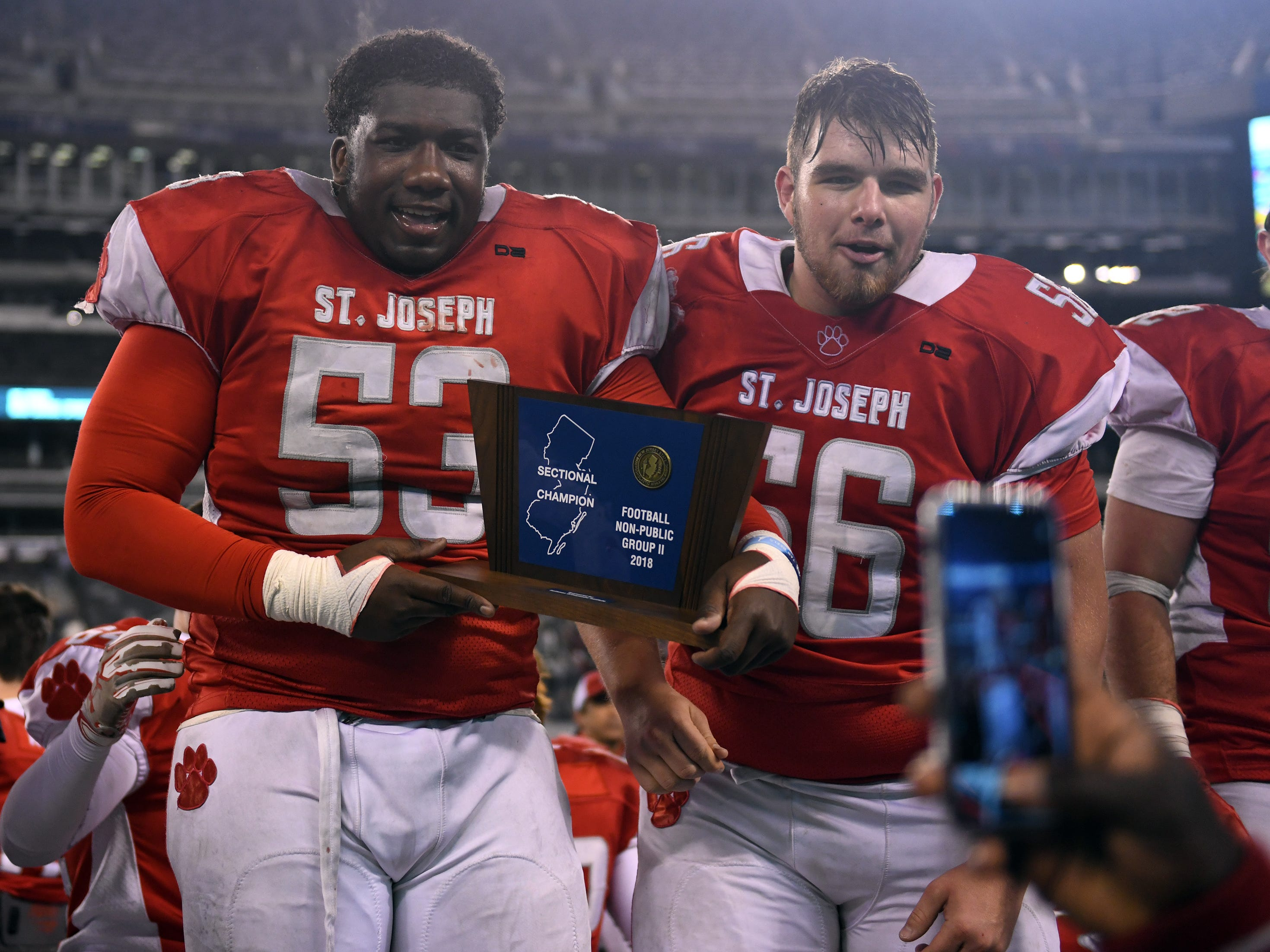 St. Joseph's Sean Morris and Tucker Monico celebrate after winning the Non-Public 2 state championship game at MetLife Stadium on Friday, November 30, 2018.