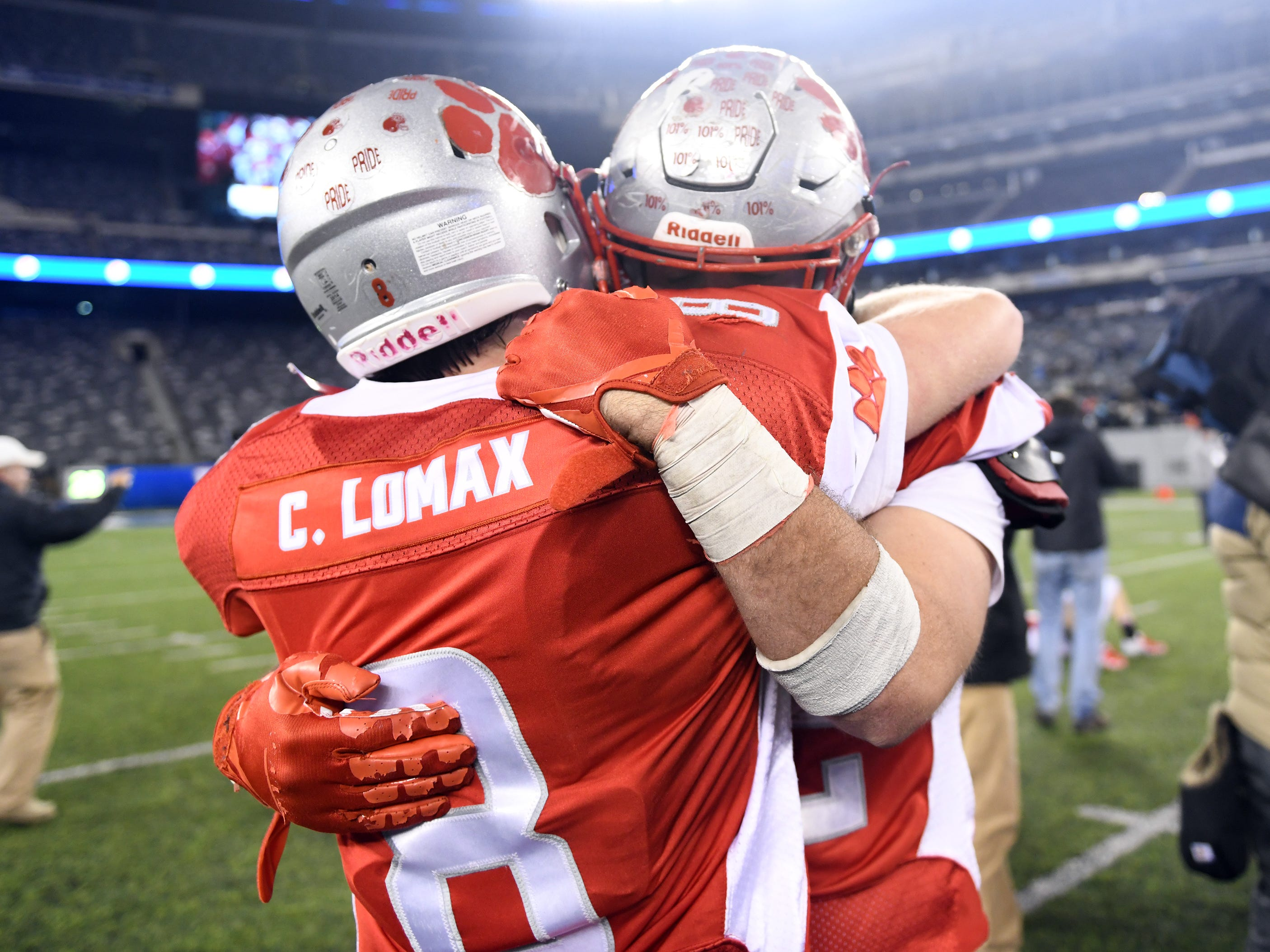 St. Joseph's Chase Lomax gives his older brother Brad a hug after winning the Non-Public 2 state championship by beating Holy Spirit. The Wildcats topped the Spartans, 41-22 at MetLife Stadium on Friday, November 30, 2018.