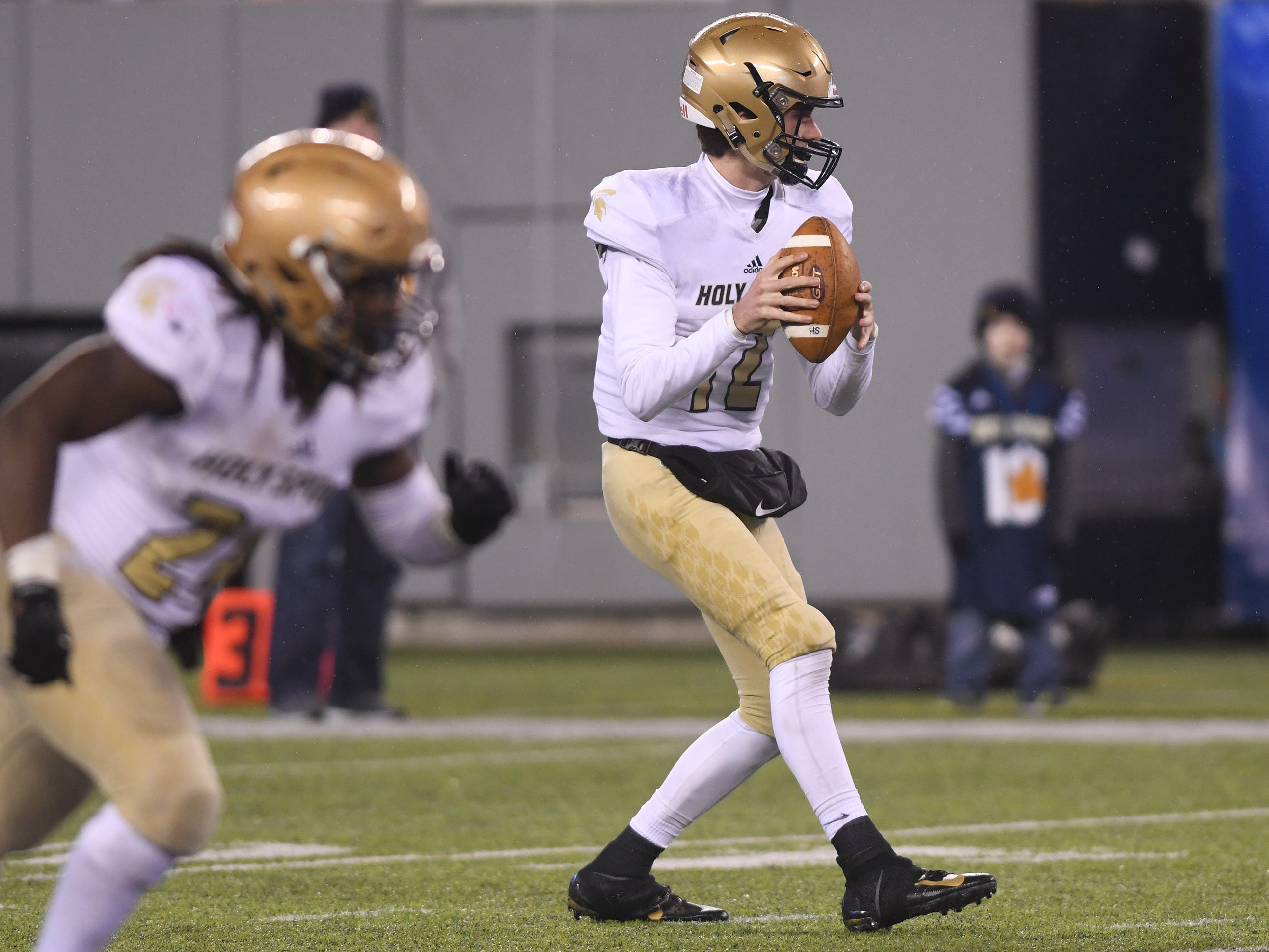 Holy Spirit's QB, Ryan Yost looks for a open receiver during a game against St. Joseph. The Wildcats defeated the Spartans, 41-22 at MetLife Stadium to win the Non-Public 2 state championship.