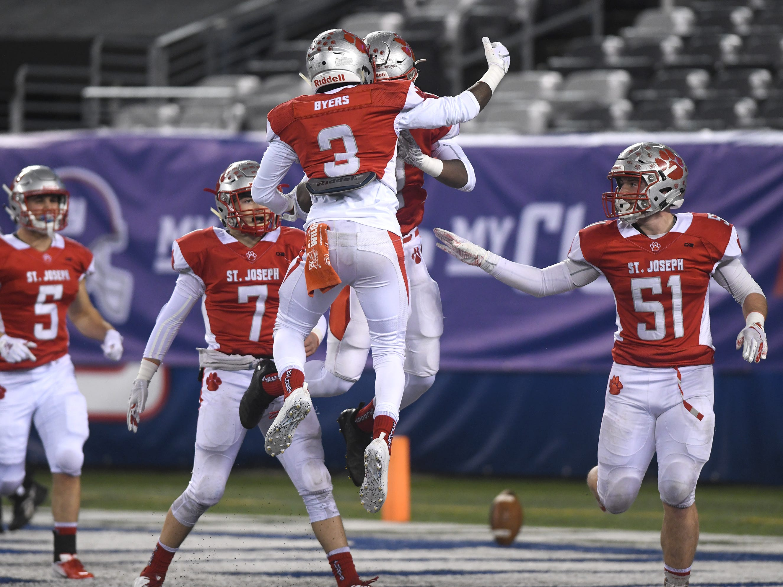 St. Joseph's Ahmad Ross (2) celebrates a touchdown run with Jada Byers (3) during a game against Holy Spirit. The Wildcats topped the Spartans, 41-22 at MetLife Stadium on Friday, November 30, 2018.