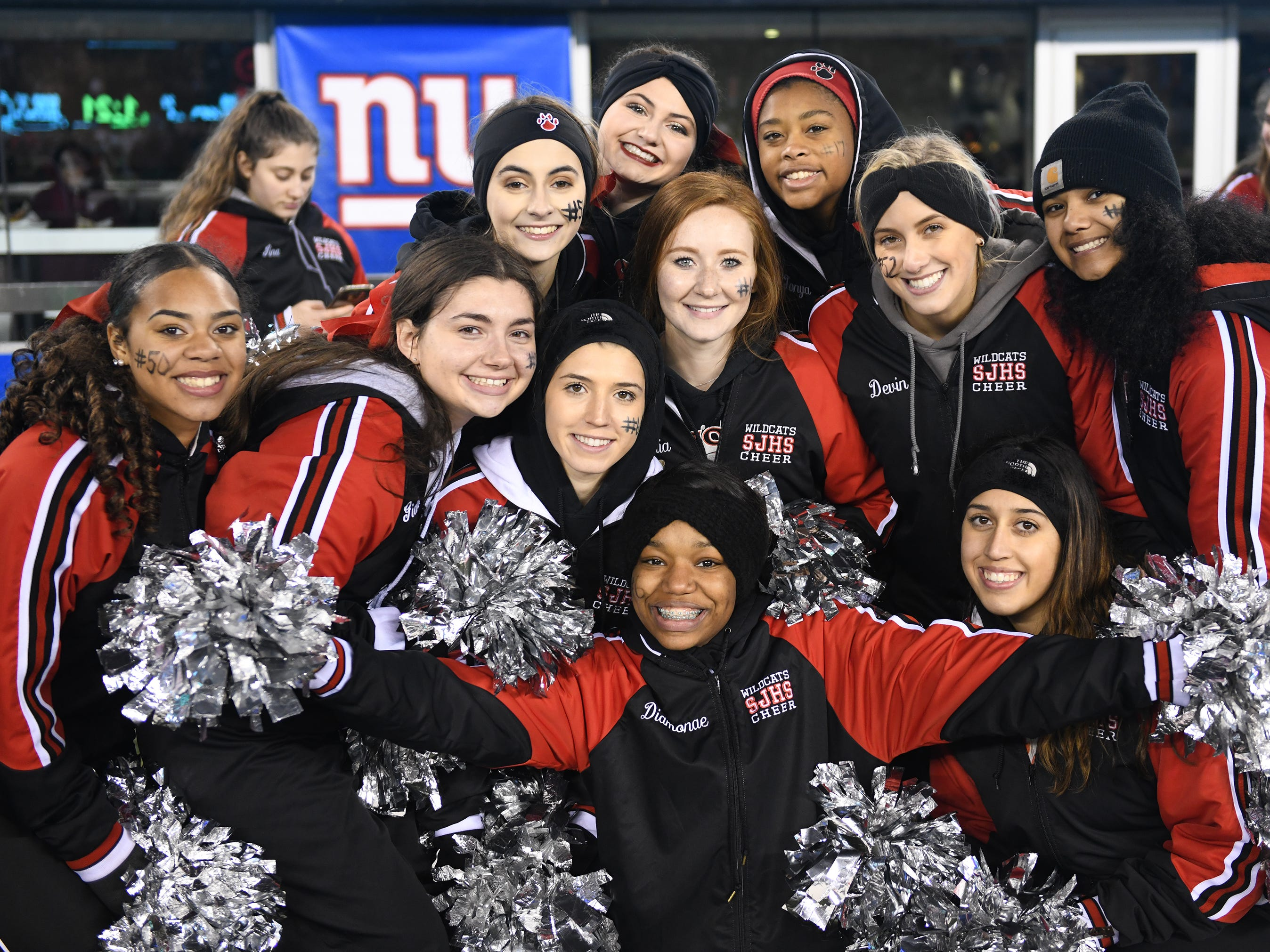 St. Joseph cheerleaders pose for a photo during the Non-Public 2 state championship game against Holy Spirit at MetLife Stadium. The Wildcats topped the Spartans, 41-22.