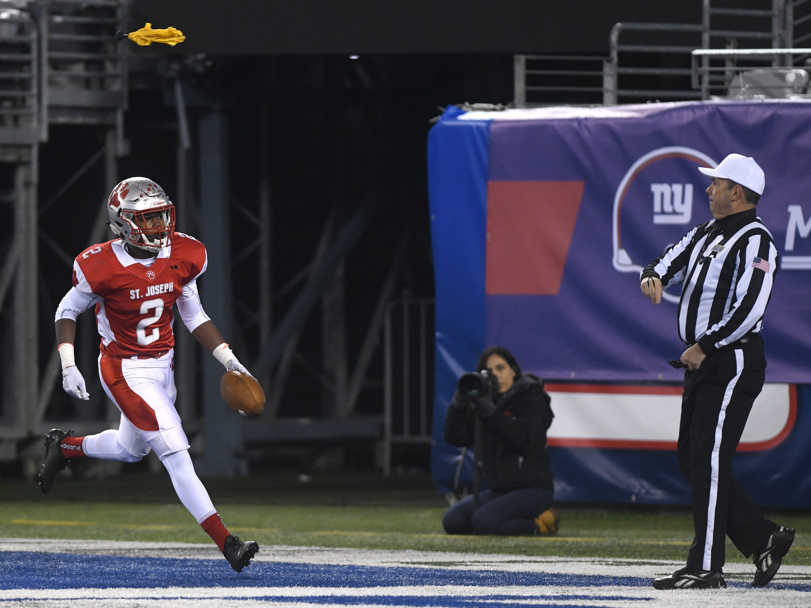 St. Joseph's Ahmad Ross runs for a touchdown against Holy Spirit. The Wildcats topped the Spartans, 41-22 at MetLife Stadium on Friday, November 30, 2018.