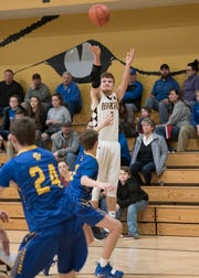 Junior Cruz McFadden rises for a jump shot during the Paint Valley game against Portsmouth Clay Friday night at Paint Valley High School. Paint Valley defeated Portsmouth Clay 63-55.