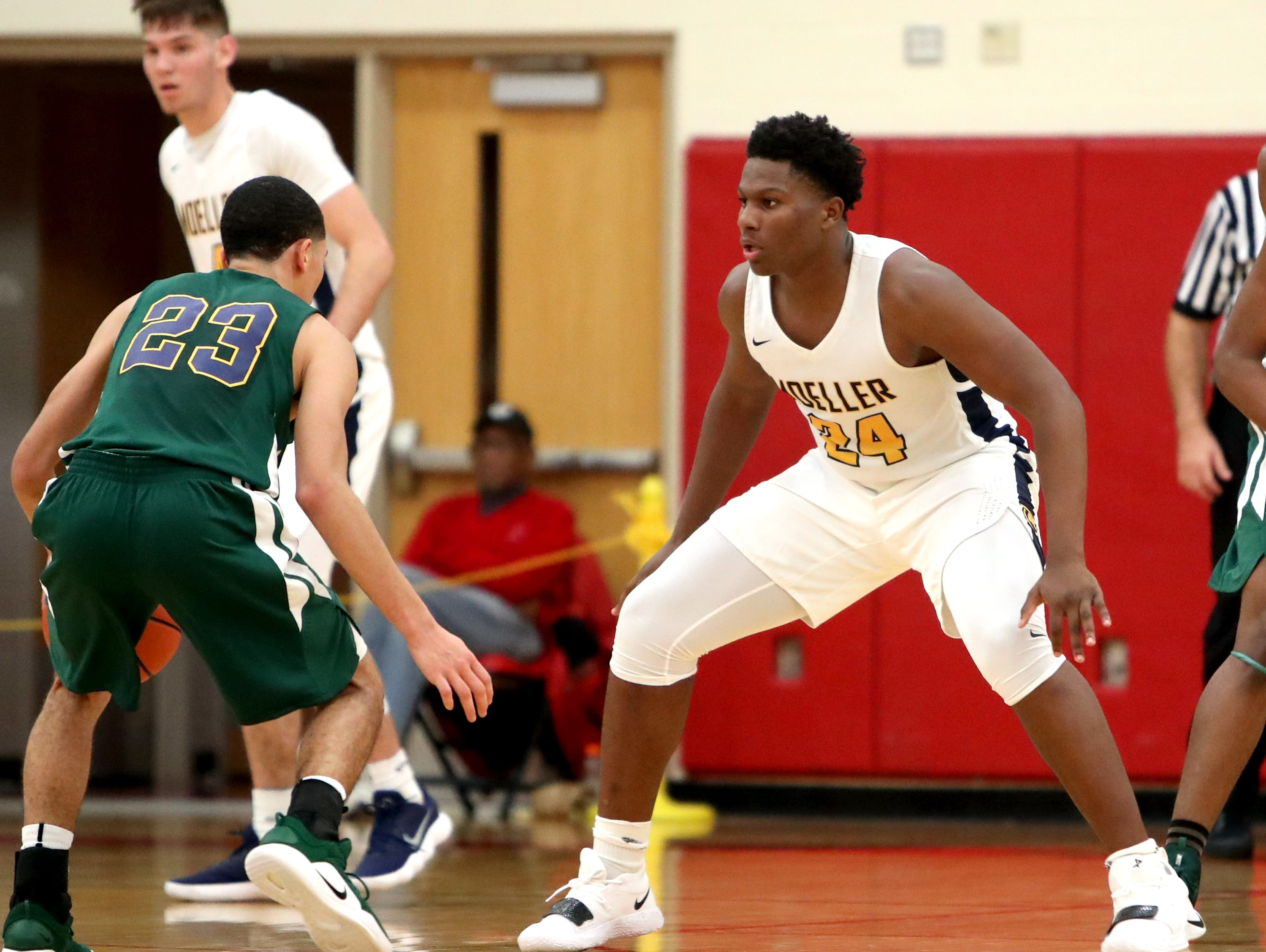 Moeller forward Alex Williams guards Bryan Station's Myles Morones at the Ohio Valley Hoops Classic at Hillsboro High School. Moeller defeated Bryan Station 85-42.