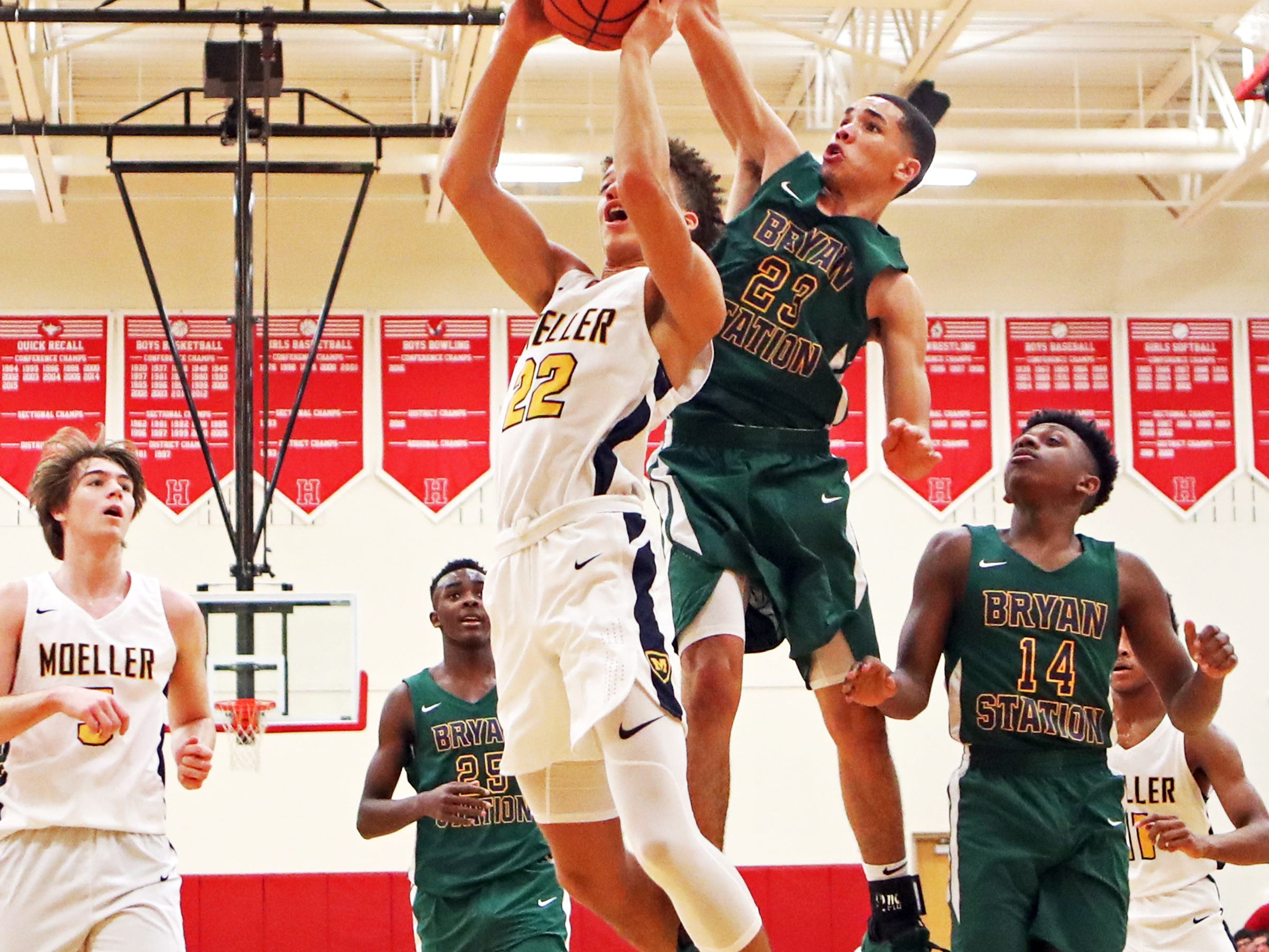 Moeller forward Max Land drives and scores at the Ohio Valley Hoops Classic at Hillsboro High School. Moeller defeated Bryan Station 85-42.