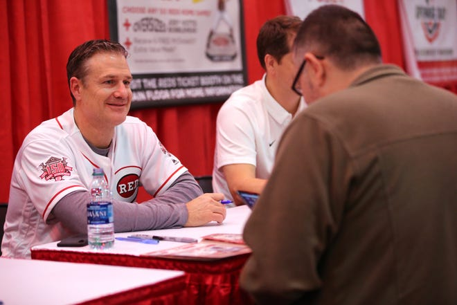 Cincinnati Reds manager David Bell signs autographs for fans during Redsfest on Friday, Nov. 30, 2018, at Duke Energy Convention Center in Cincinnati.