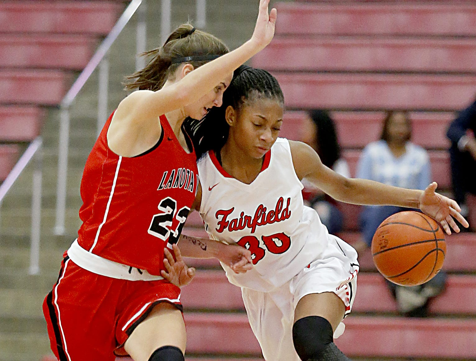 Lakota West's Kailyn Dudukovich pressures Fairfield forward Tori Williams during their game at Fairfield Saturday, Dec. 1, 2018.