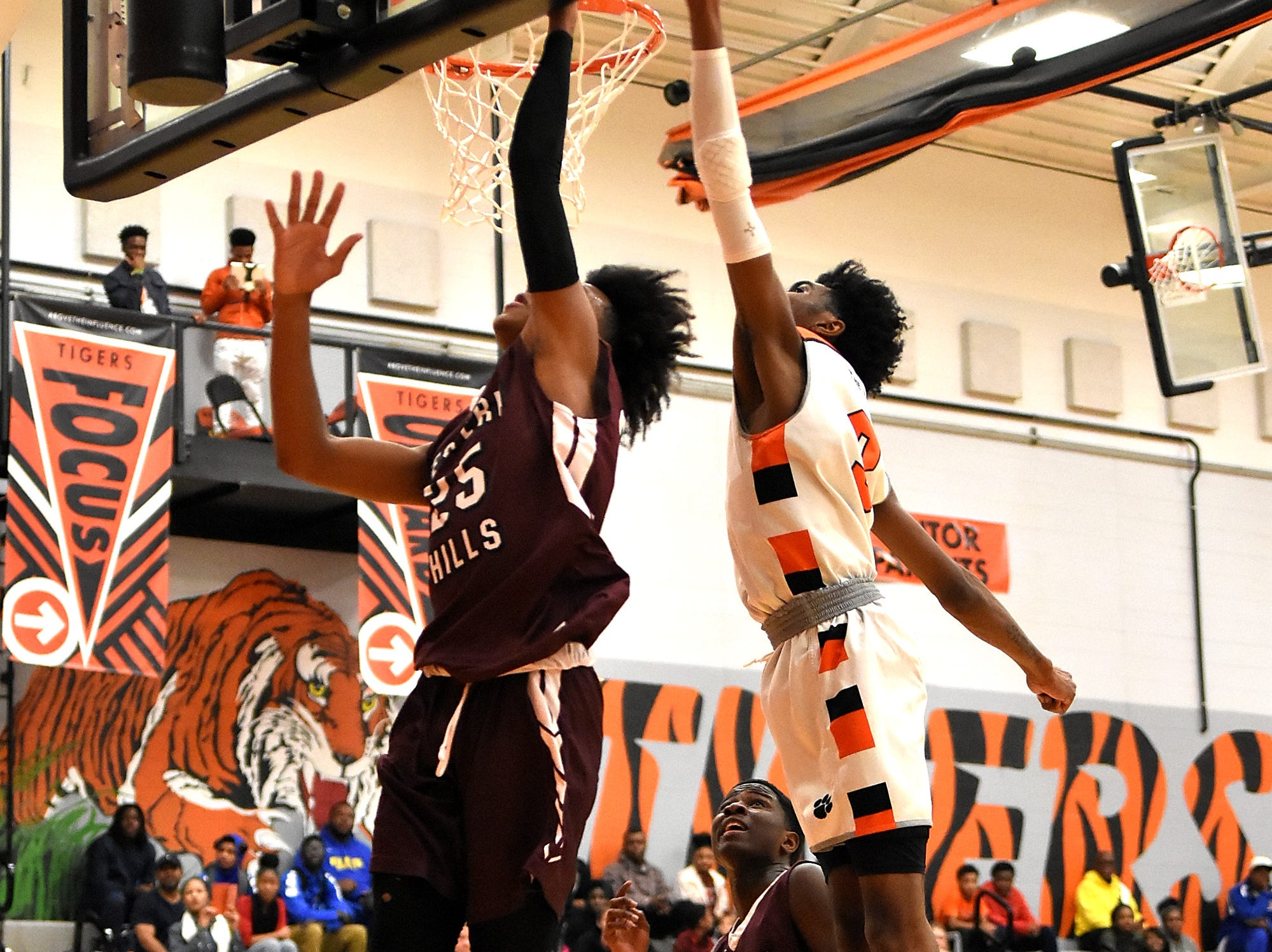 Demetrius Watkins (25) powers to the board scoring a basket for Western Hills in their win over Withrow, November 30, 2018.