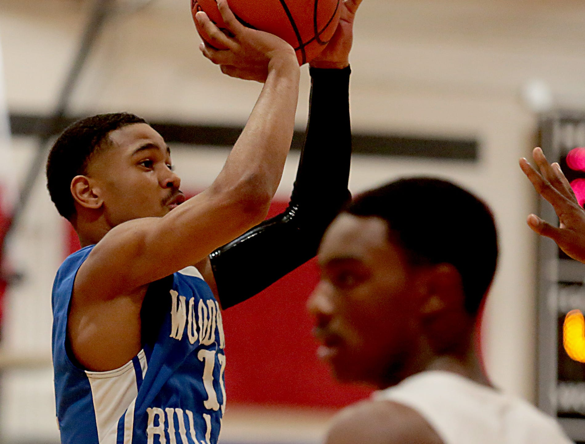 Woodward guard Aaron Davis connects for two against Hughes during their game at Hughes in Clifton Friday, Nov. 30, 2018.