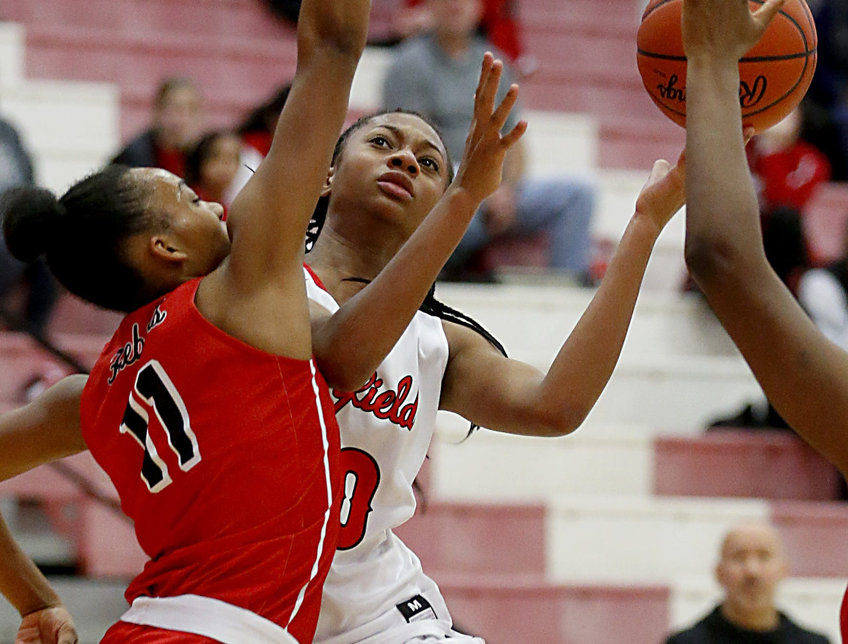 Fairfield forward Tori Williams shoots while defended by Lakota West's Dominique Camp during their game at Fairfield Saturday, Dec. 1, 2018.