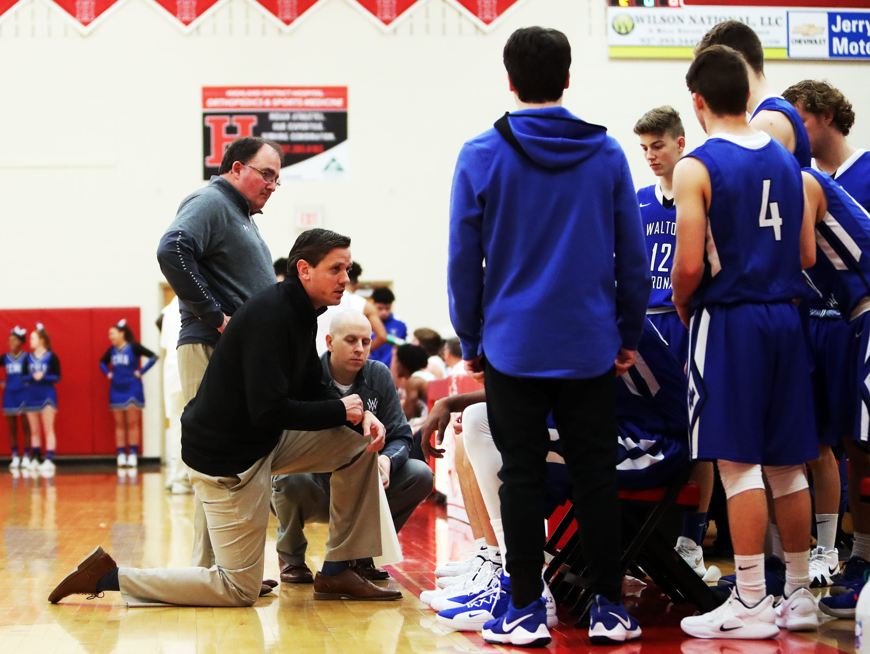 Walton Verona head coach Grant Brannen instructs his team during a time out at the Ohio Valley Hoops Classic at Hillsboro High School. Walton Verona defeated Xenia 62-54.