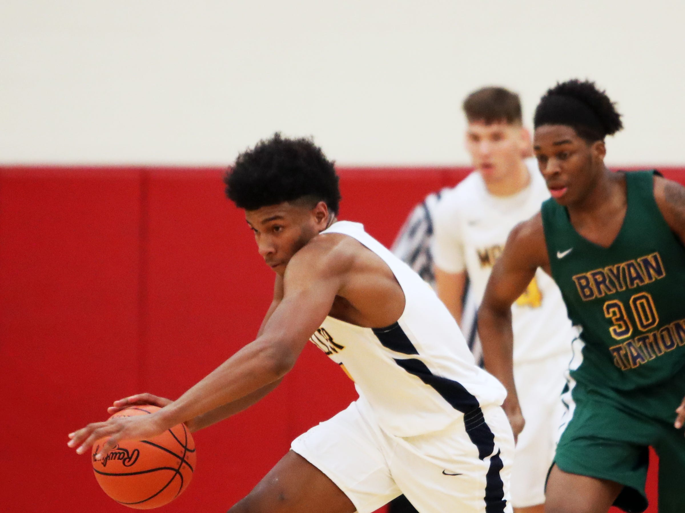 Moeller guard Miles McBride makes a steal and starts a fast break at the Ohio Valley Hoops Classic at Hillsboro High School. Moeller defeated Bryan Station 85-42.