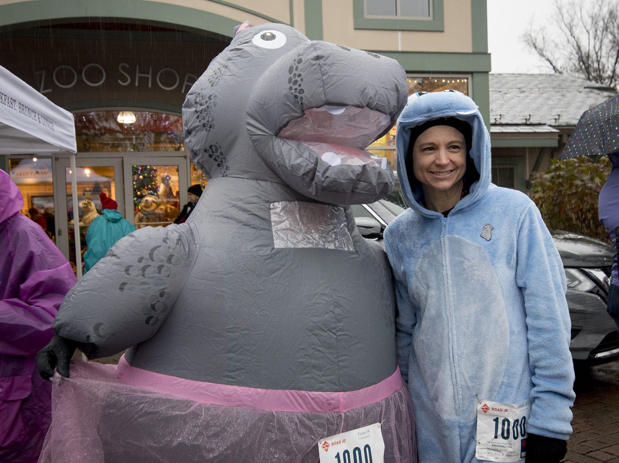 "Michelle Siekerman of Mt. Healthy poses with ""Fiona"" at the Cincinnati Zoo's Fiona 1k walk in honor of the beloved hippo's 1,000-pound milestone Saturday, December 1, 2018 in Cincinnati, Ohio."