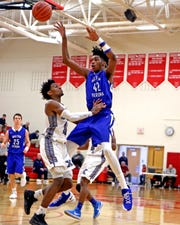Walton Verona center Dieonte Miles draws a defender in and makes a pass at the Ohio Valley Hoops Classic at Hillsboro High School. Walton Verona defeated Xenia 62-54.