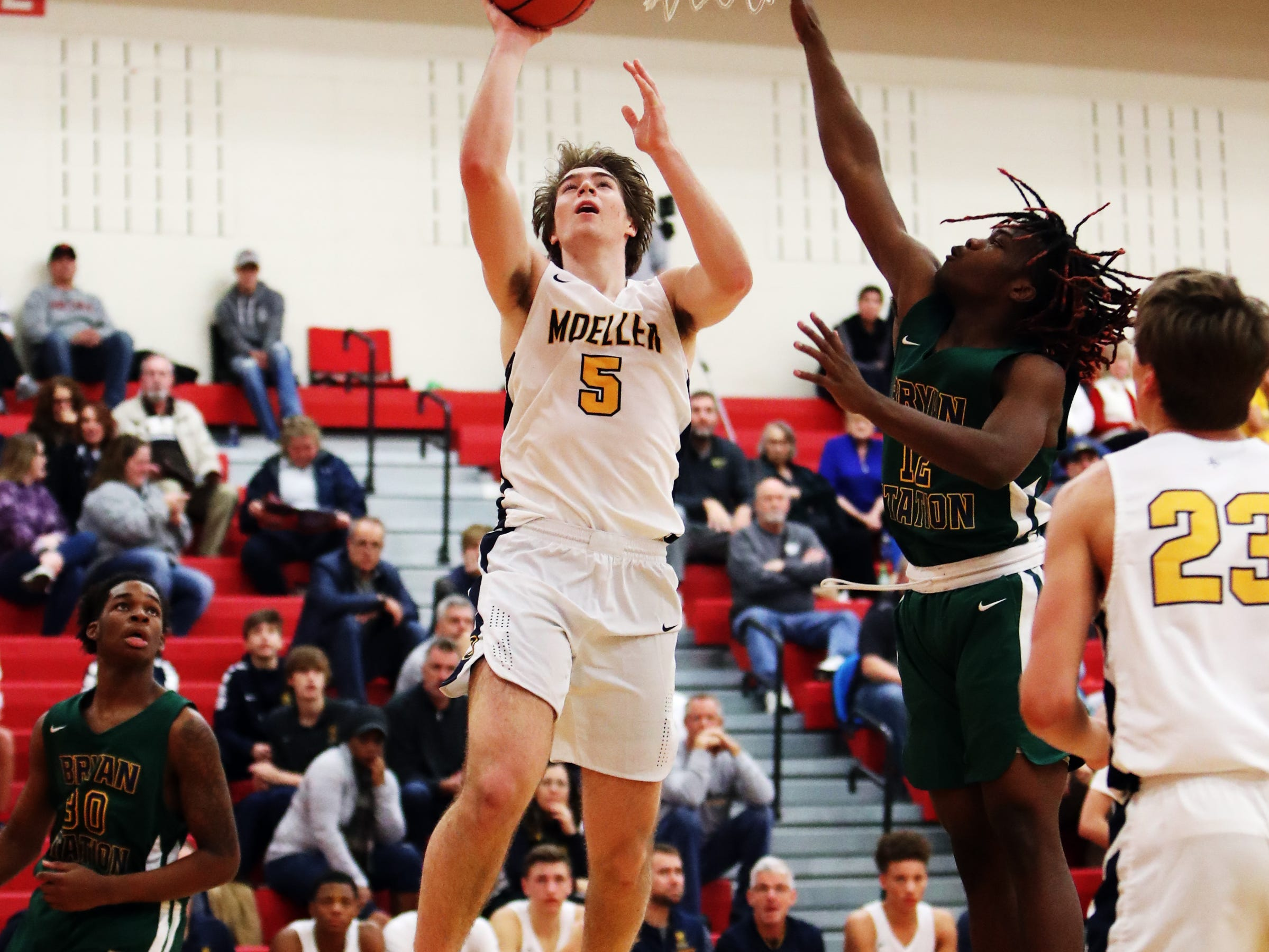 Moeller guard Alec Pfreim scores on a fast break opportunity at the Ohio Valley Hoops Classic at Hillsboro High School. Moeller defeated Bryan Station 85-42.