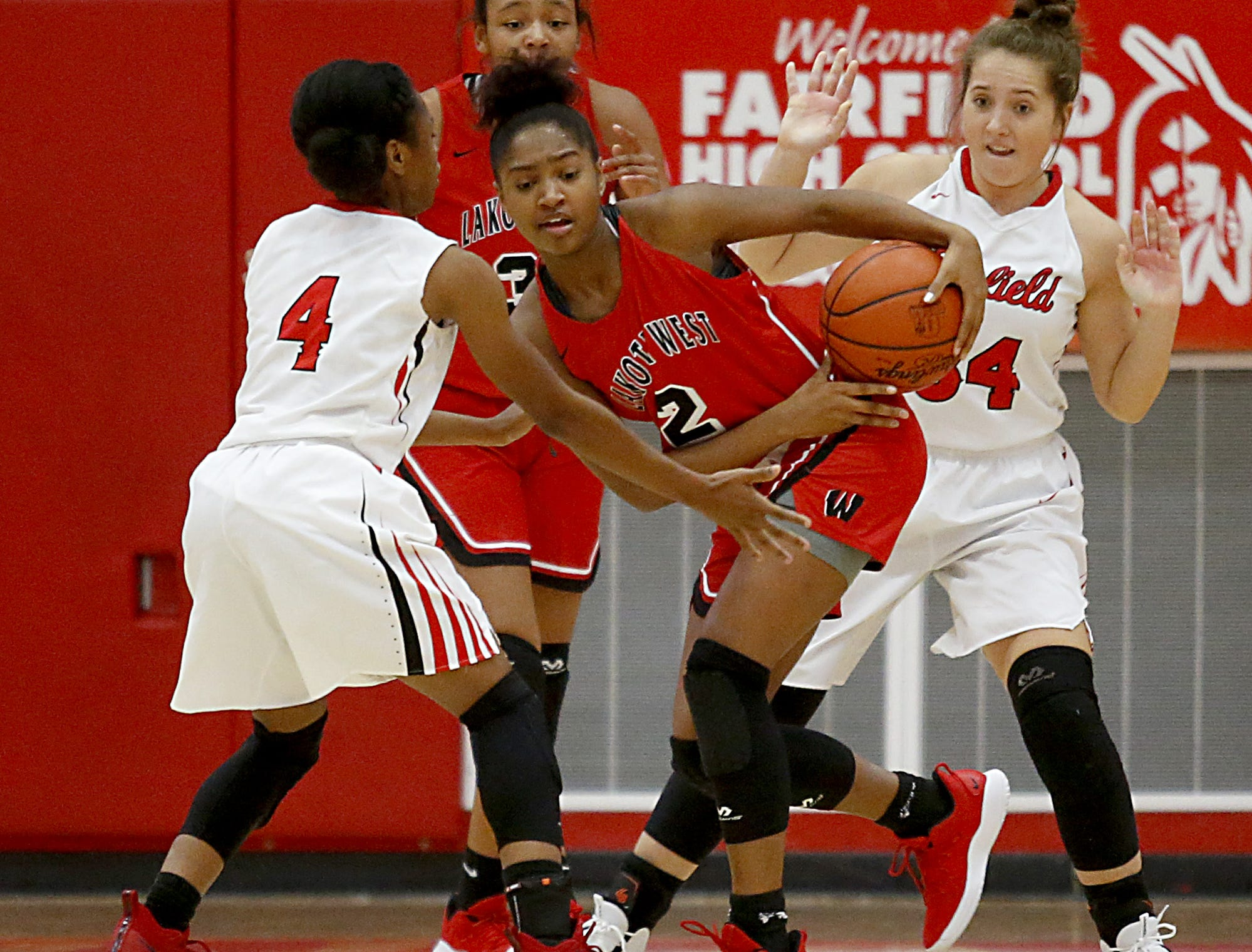Fairfield guard Zahrya Bailey tries to steal from Lakota West guard Chance Gray during their game at Fairfield Saturday, Dec. 1, 2018.
