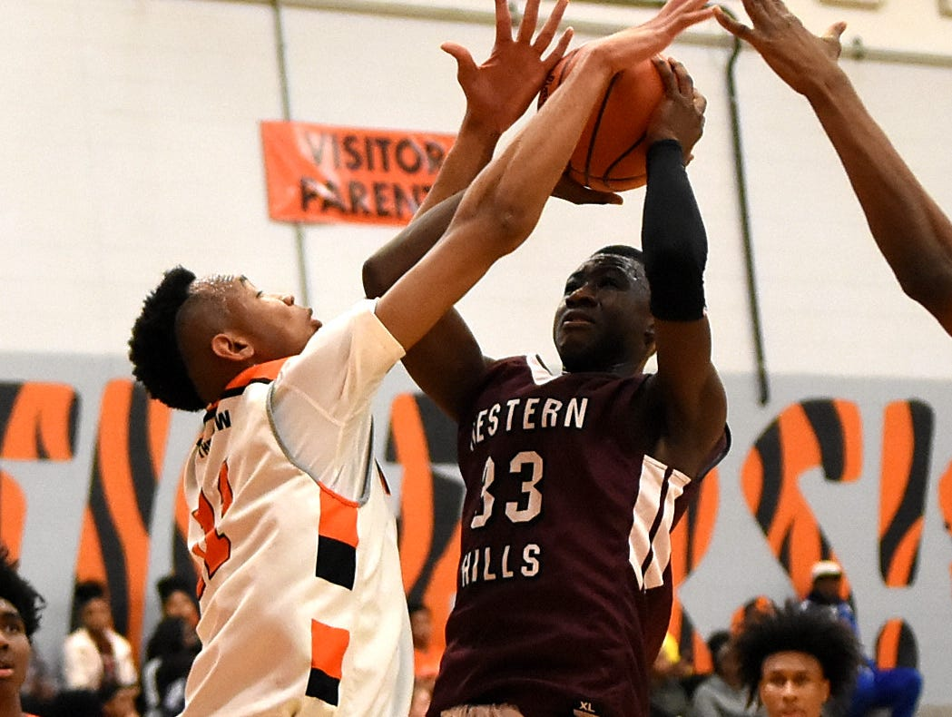 Withrow's Abba Lawal (11) blocks the shot of Aboubacar Cisse (33) of Western Hills, Nov. 30, 2018.