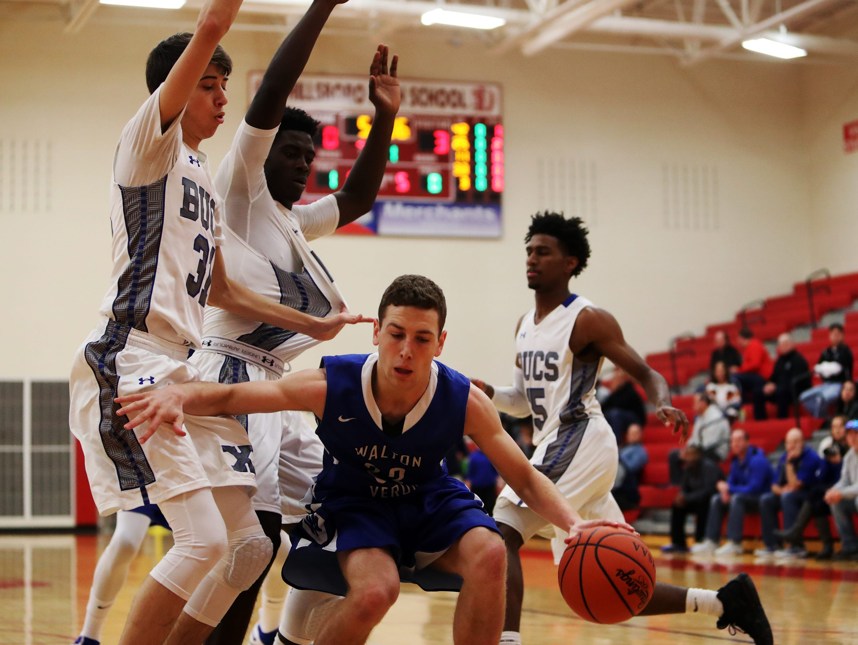 Walton Verona guard Grant Grubbs finds his way to the rim blocked by Xenia's Johnzel Gray, center, and Noah Crawford at the Ohio Valley Hoops Classic at Hillsboro High School.
