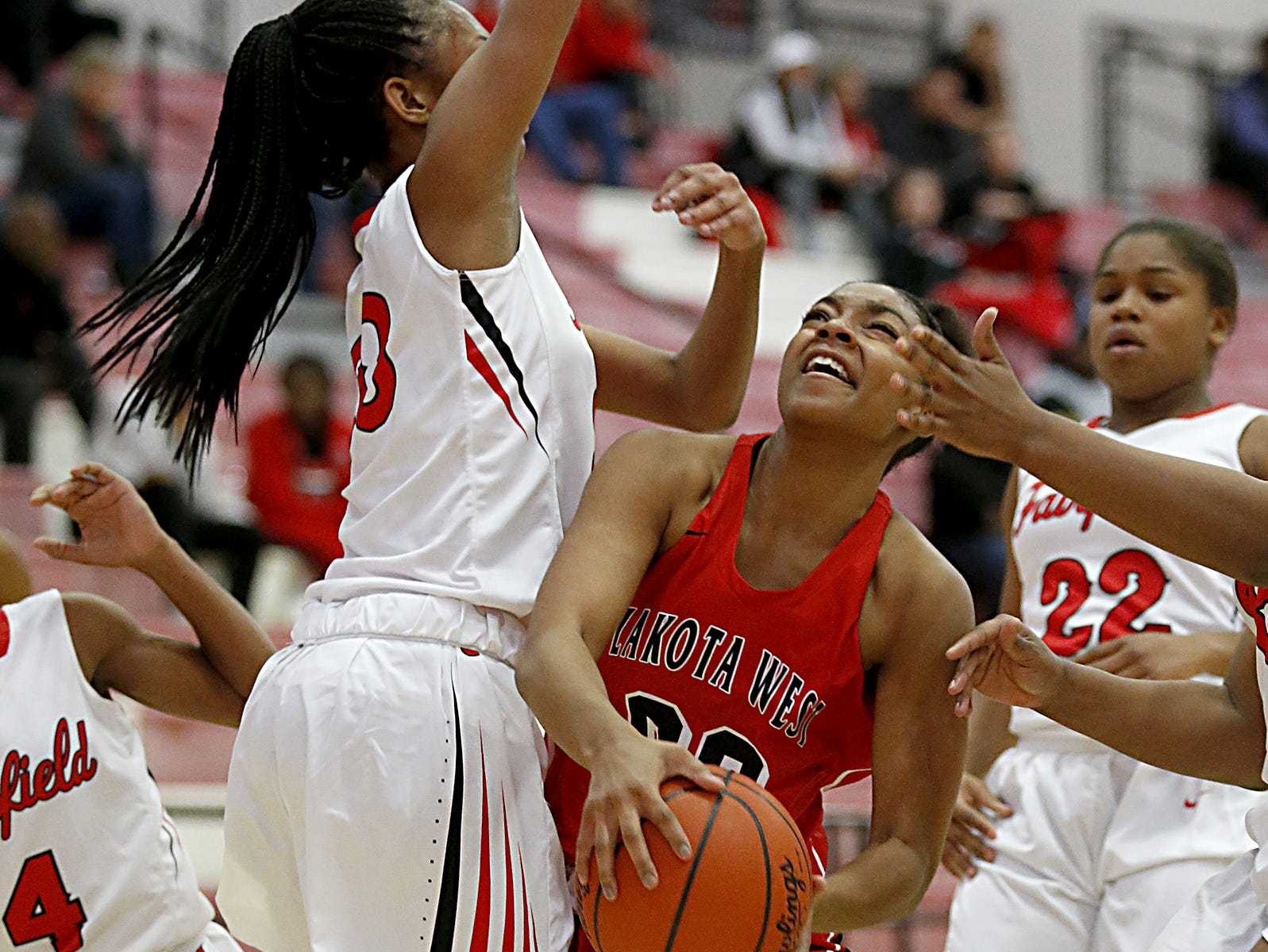 Lakota West guard Jaydis Gales is covered by Fairfield forward Tori Williams during their game at Fairfield Saturday, Dec. 1, 2018.