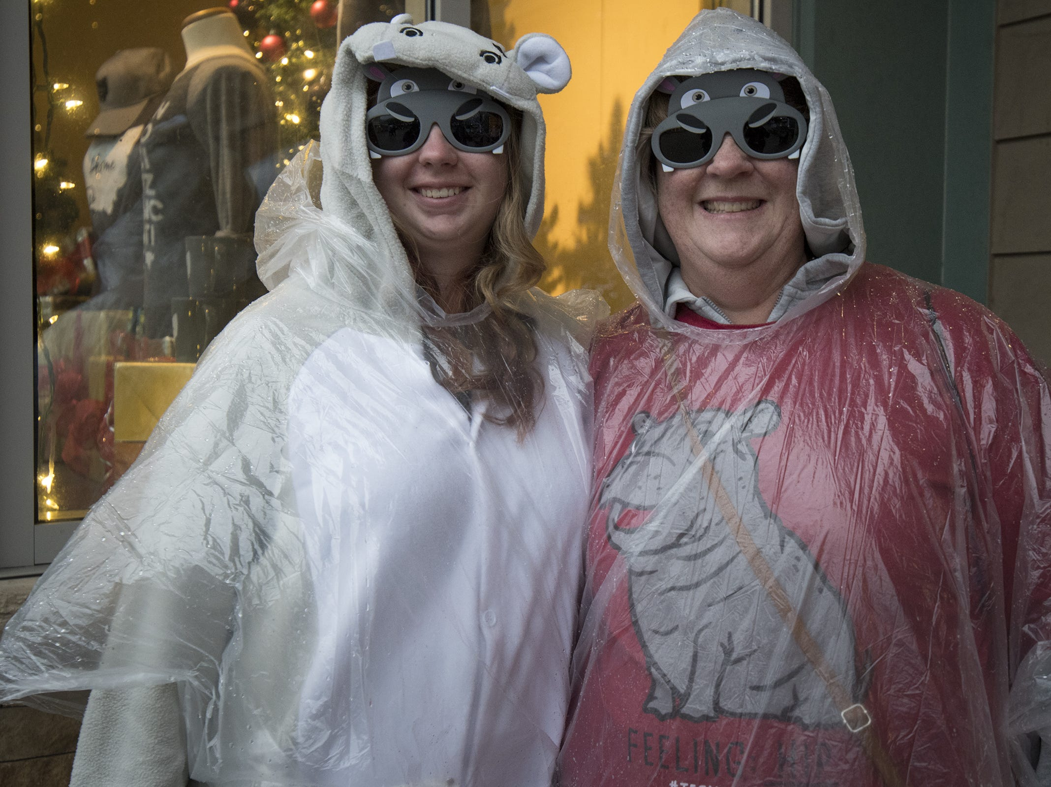 Lisa and Victoria Steuver of Bright show off their Fiona gear at the Cincinnati Zoo's Fiona 1k walk in honor of the beloved hippo's 1,000-pound milestone Saturday, December 1, 2018 in Cincinnati, Ohio.