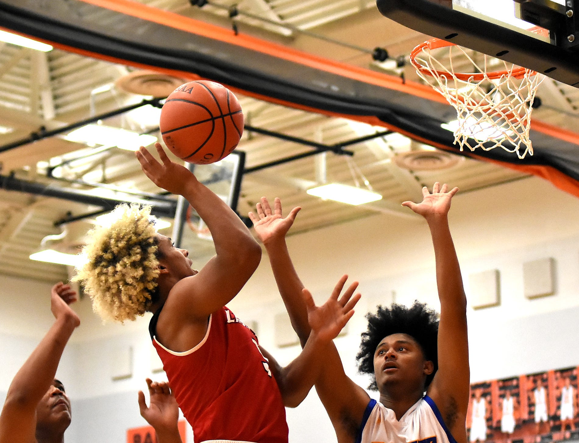 Deon Campbell eyes a basket from the baseline for La Salle, Nov. 30, 2018.