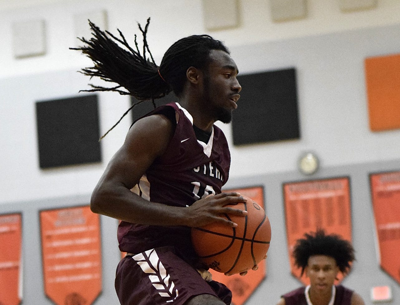 Zion Reynolds of Western Hills makes a steal for the Mustangs, Nov. 30, 2018.