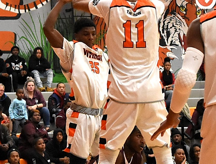Withrow's Dare Moffett (25) and Abba Lawal (11) take to the air and squeeze a hard defense on West Hills, Nov. 30, 2018.