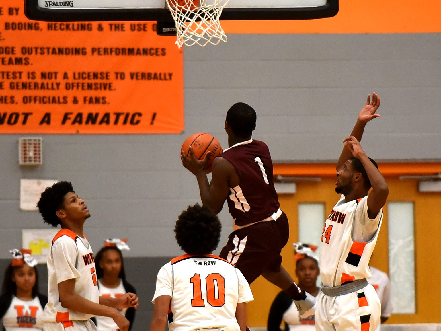 Kavion Britton sails to the basket for Western Hills as they top Withrow 73-66, November 30, 2018.