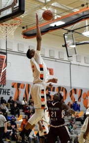 Abba Lawal of Withrow takes to the air to block a shot for the Tigers, Nov.30, 2018.