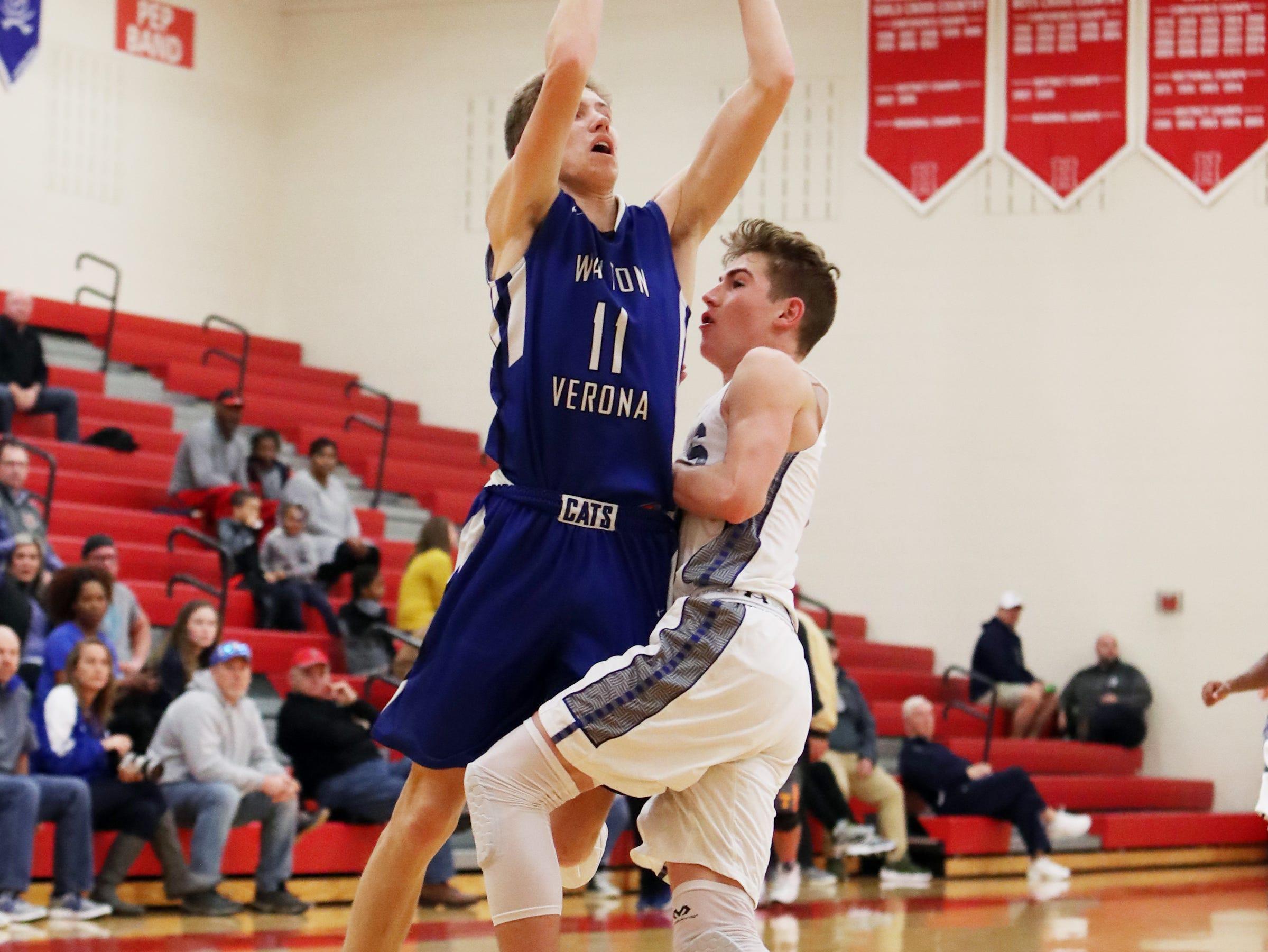 Walton Verona guard Trey Bonne drives and scores at the Ohio Valley Hoops Classic at Hillsboro High School. Walton Verona defeated Xenia 62-54.