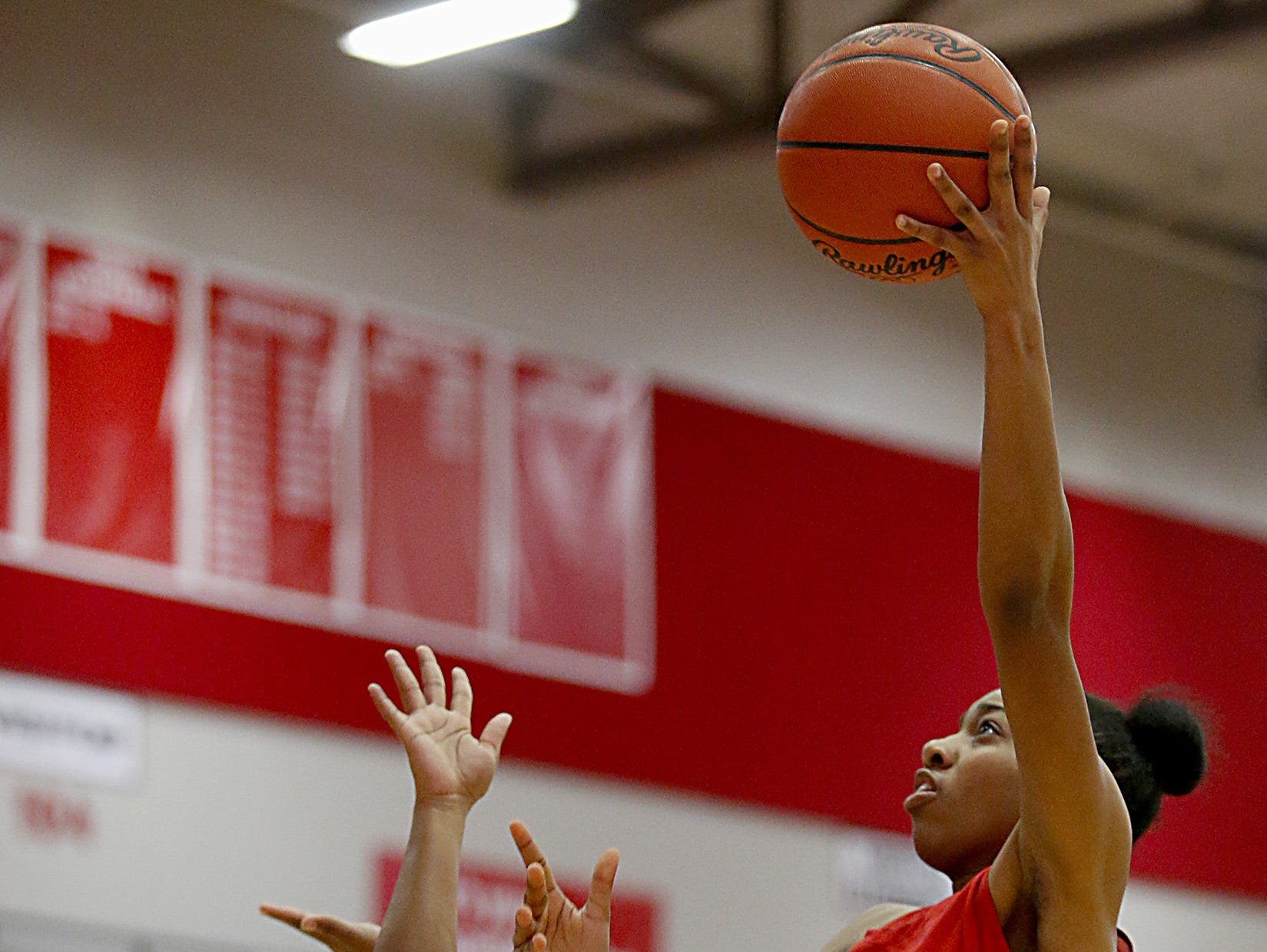 Lakota West's Dominique Camp shoots over Fairfield guard Journee Hicks during their game at Fairfield Saturday, Dec. 1, 2018.